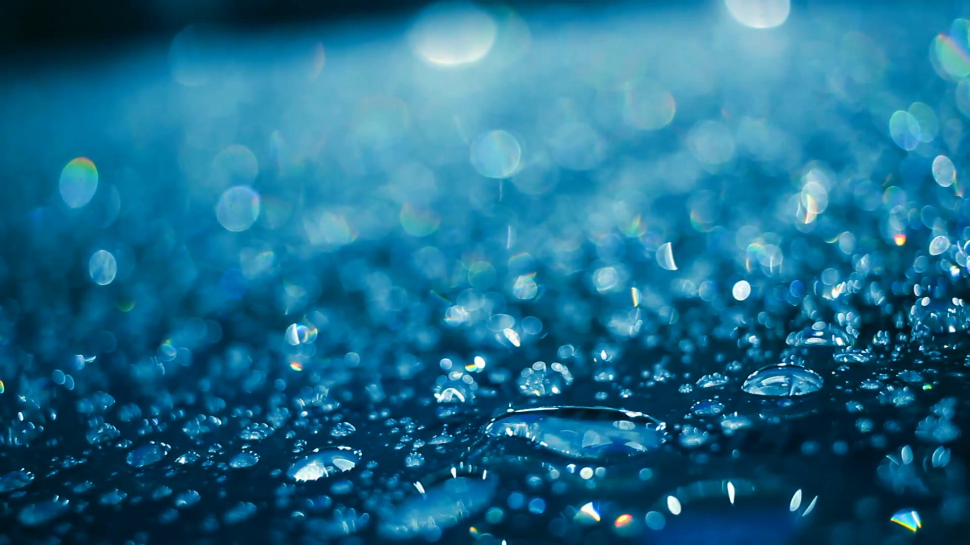 Water drops on glass after rain. Water droplets on glass in blue ...