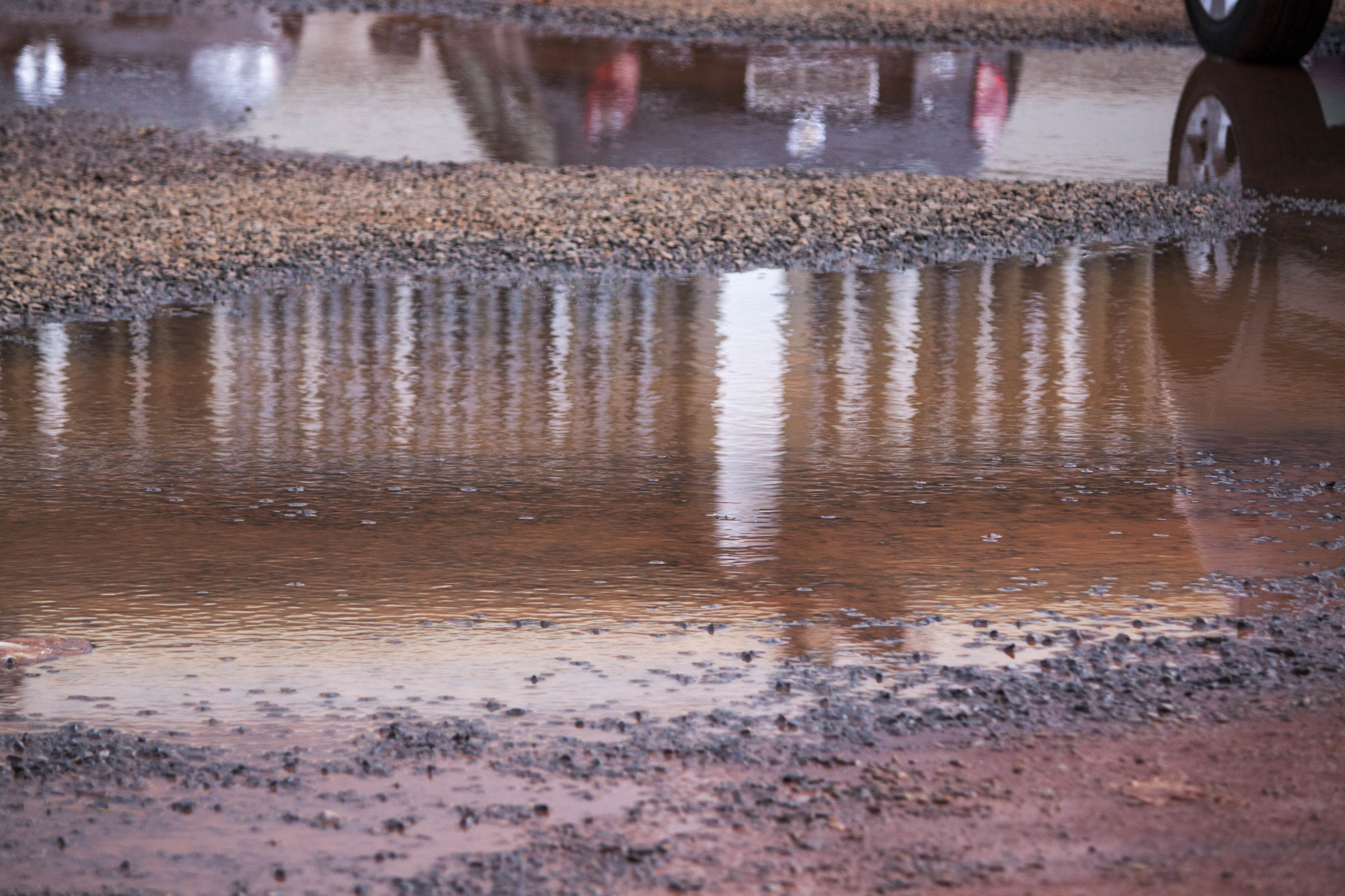 Water puddle in parking lot photo