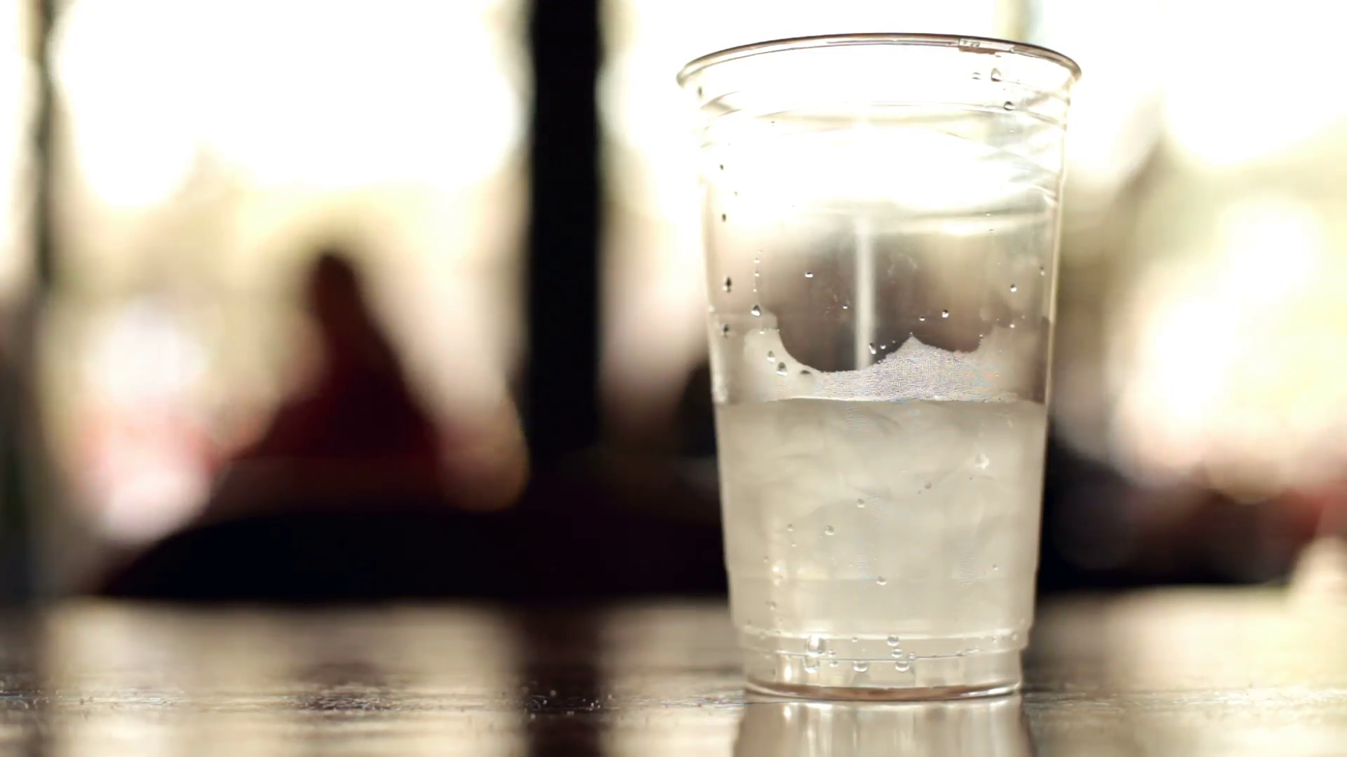 Cup of water with ice on table Stock Video Footage - Videoblocks
