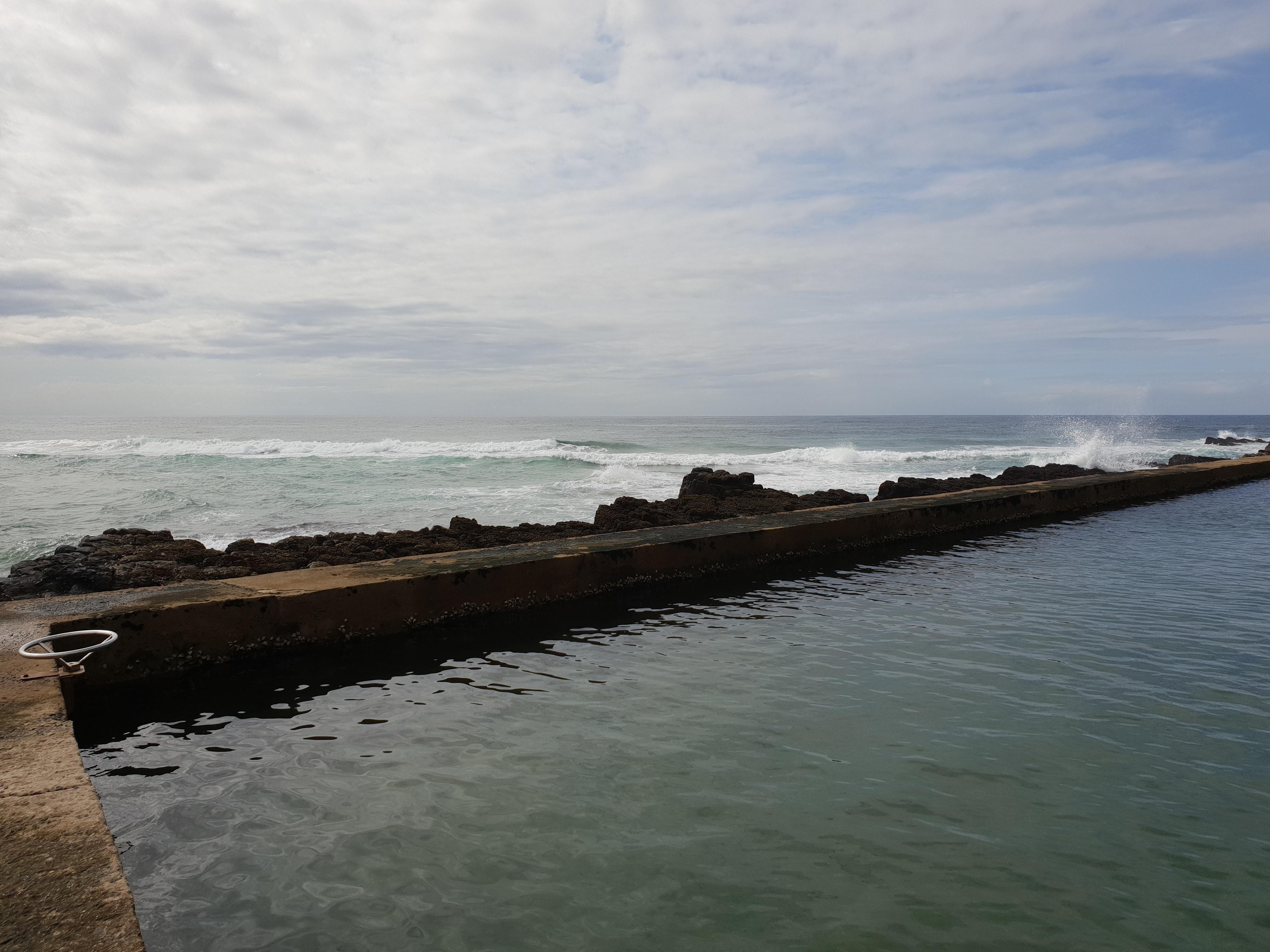 Waves crashing on the bay area photo