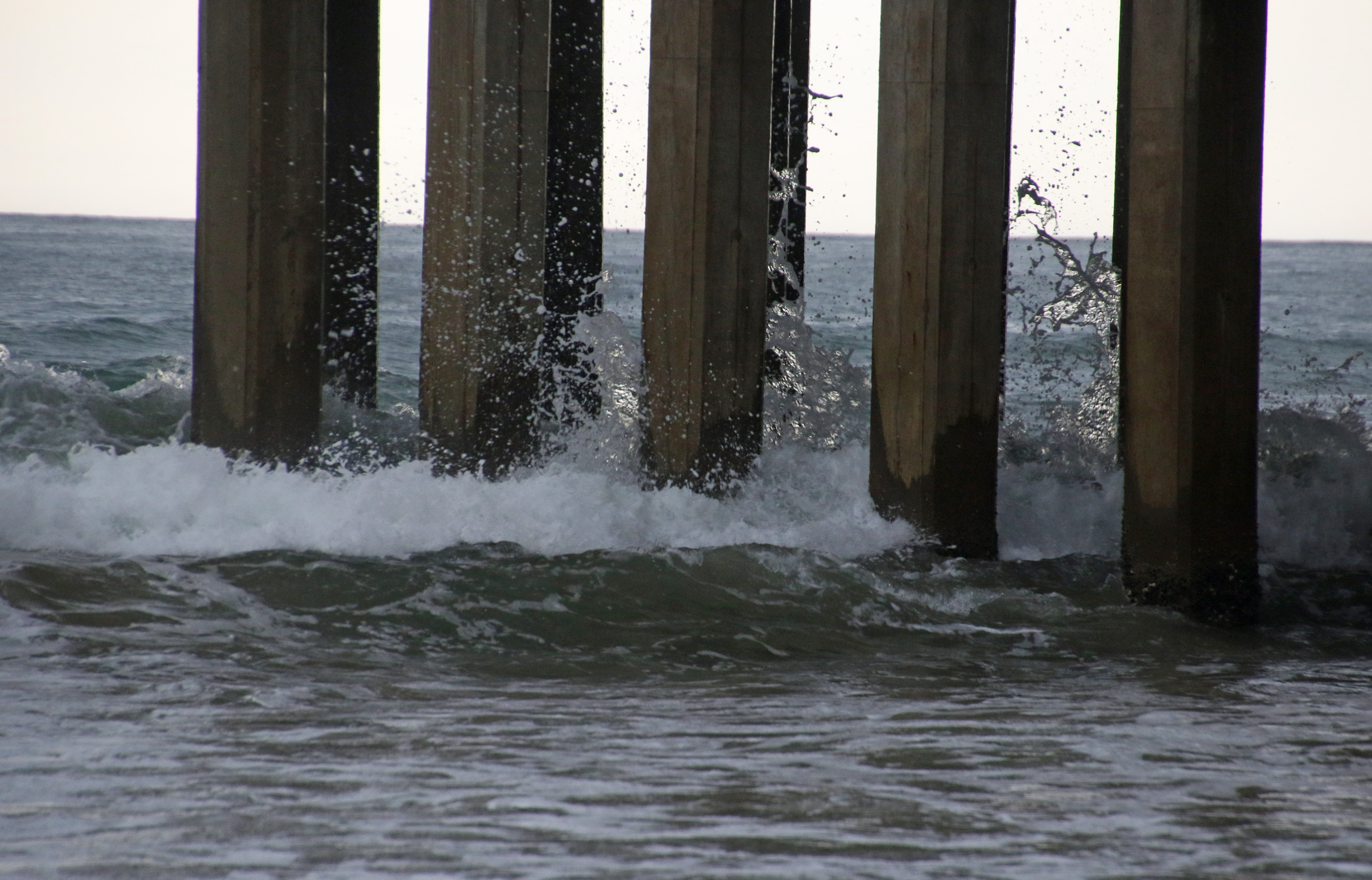 Waves crashing on the pier photo