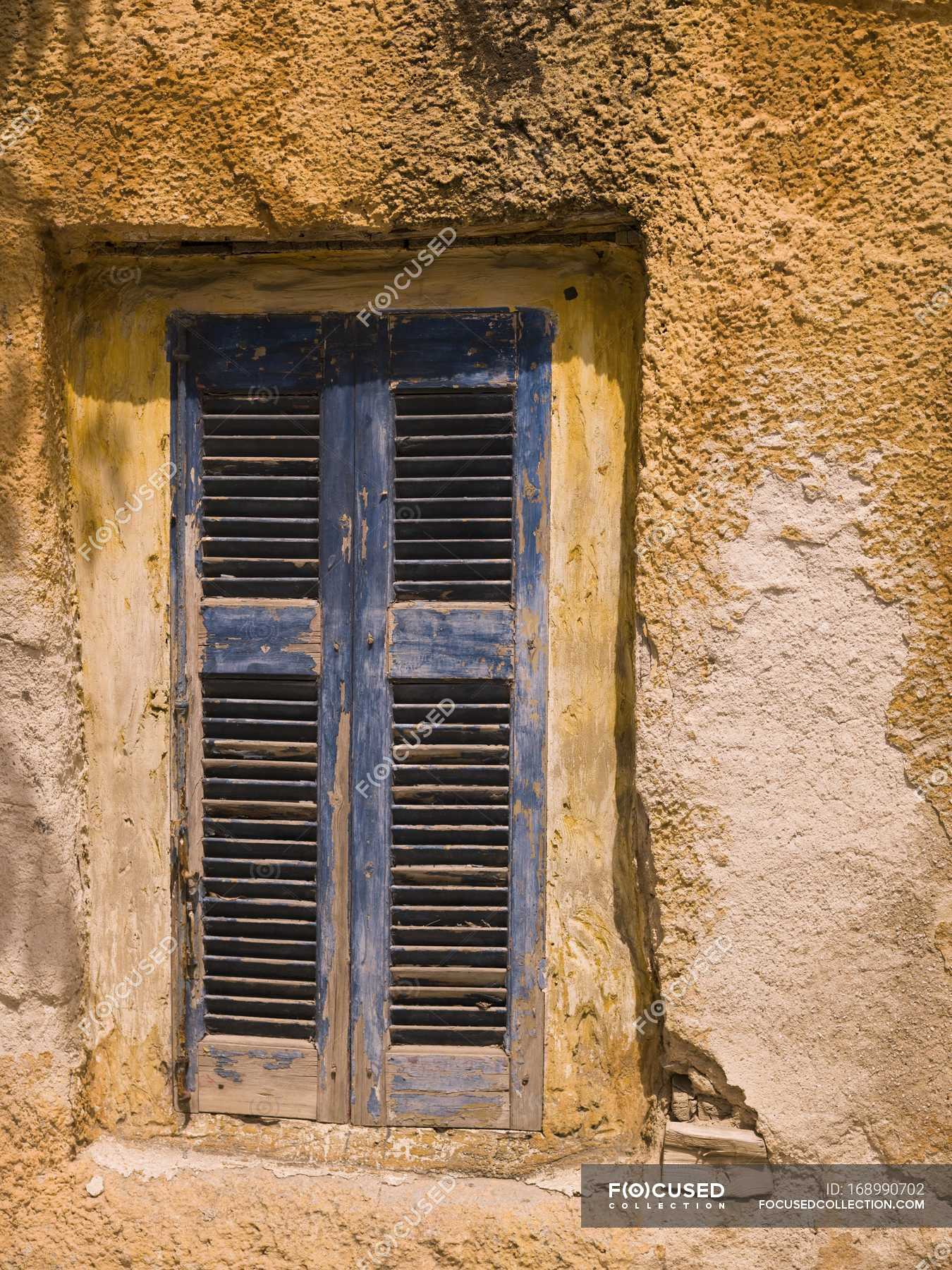 Weathered Window with shutters — Stock Photo | #168990702