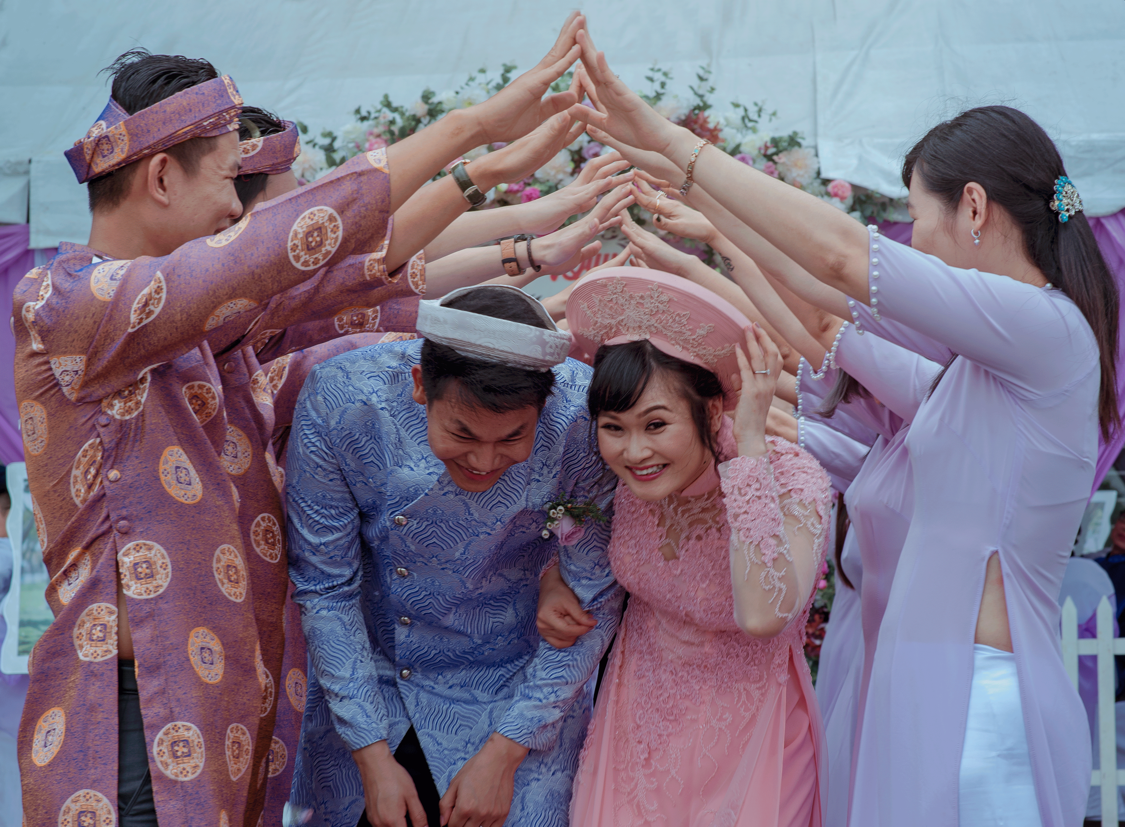 Wedding couple taking a traditional ceremony photo