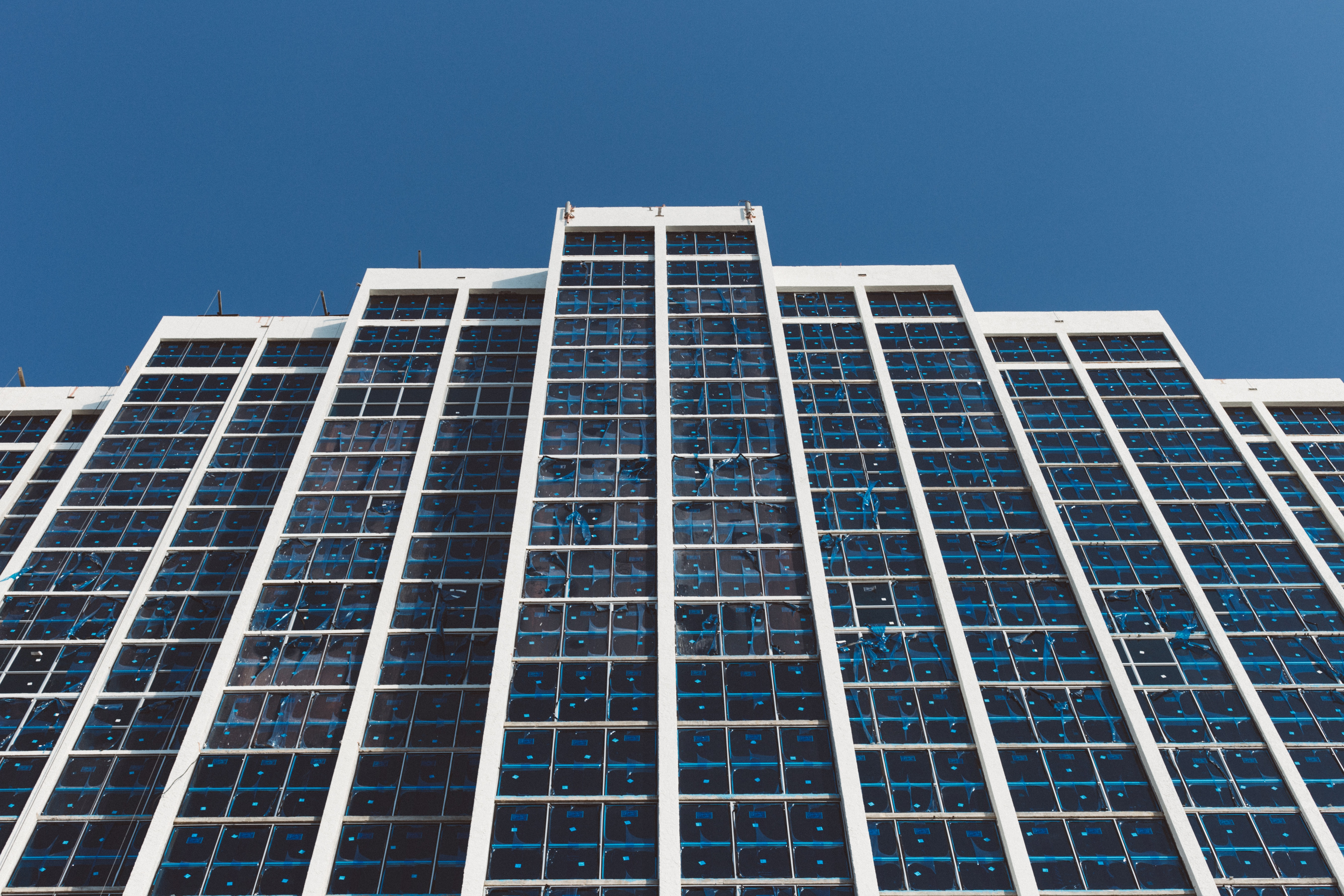 White and blue high rise building under blue sky during daytime photo