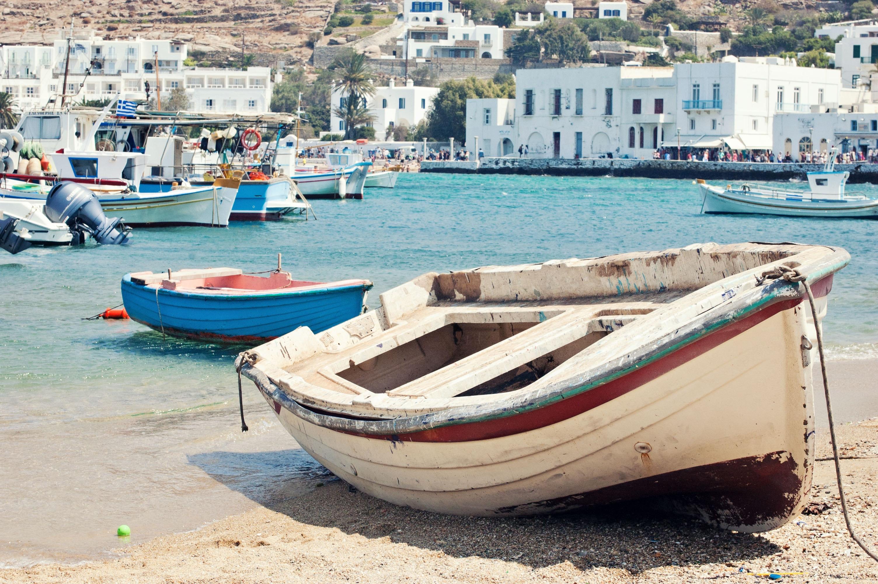 White and maroon jon boat on seashore photo