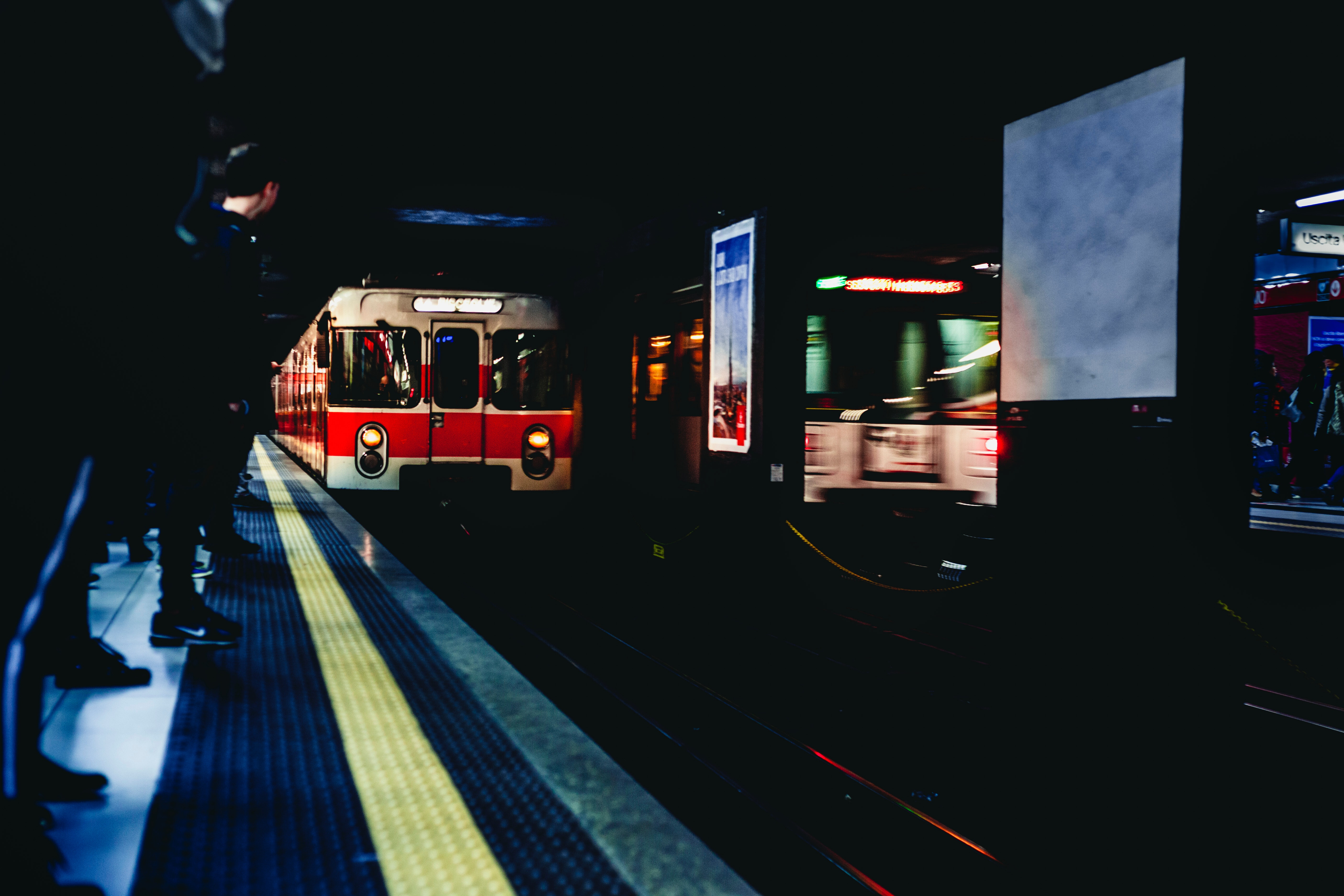 White and red train in underground photo