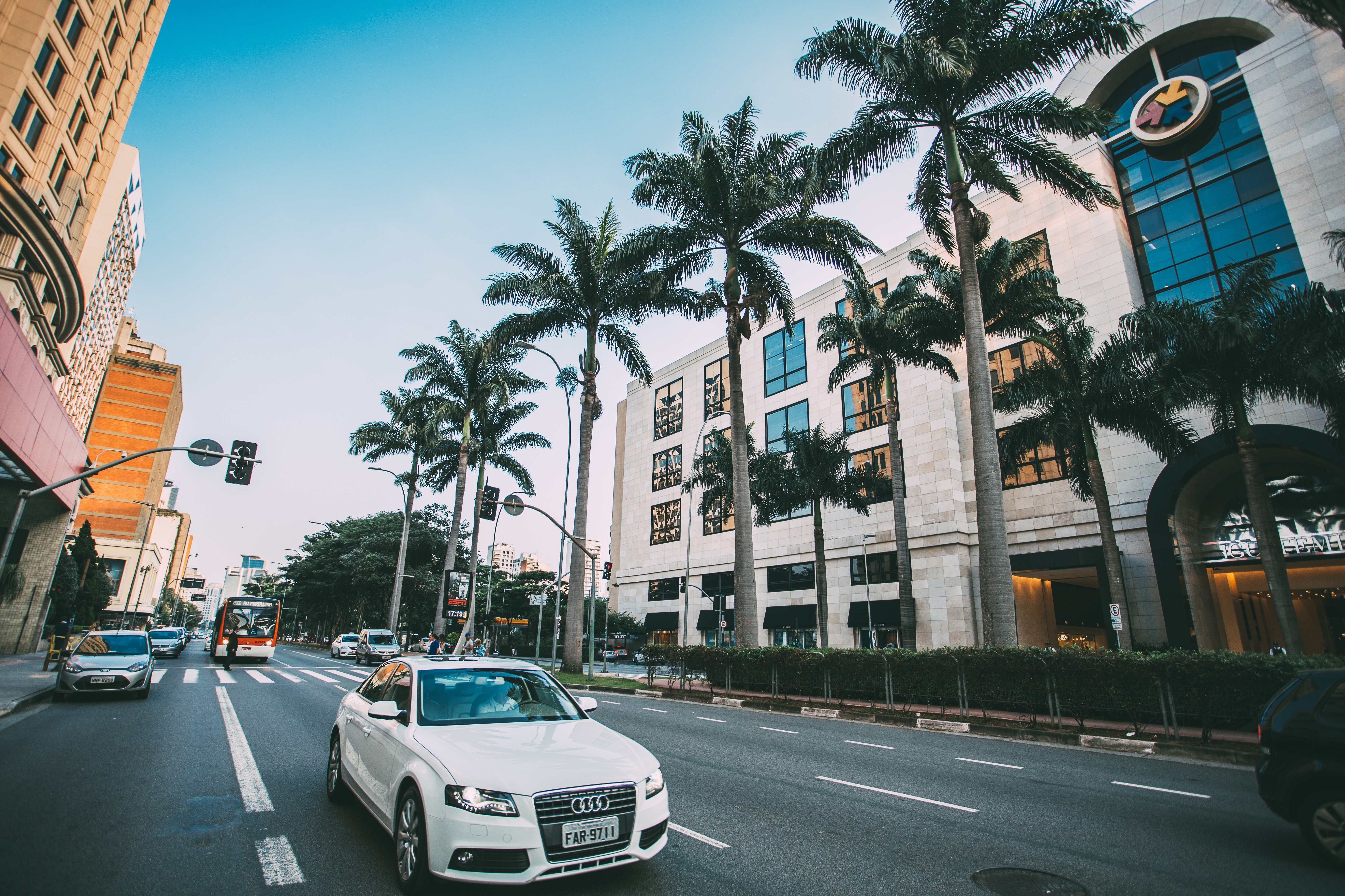 White Audi Sedan on Gray Concrete Road Near Green Trees Surround by Concrete Buildings, Architecture, Palm trees, Urban, Transportation system, HQ Photo