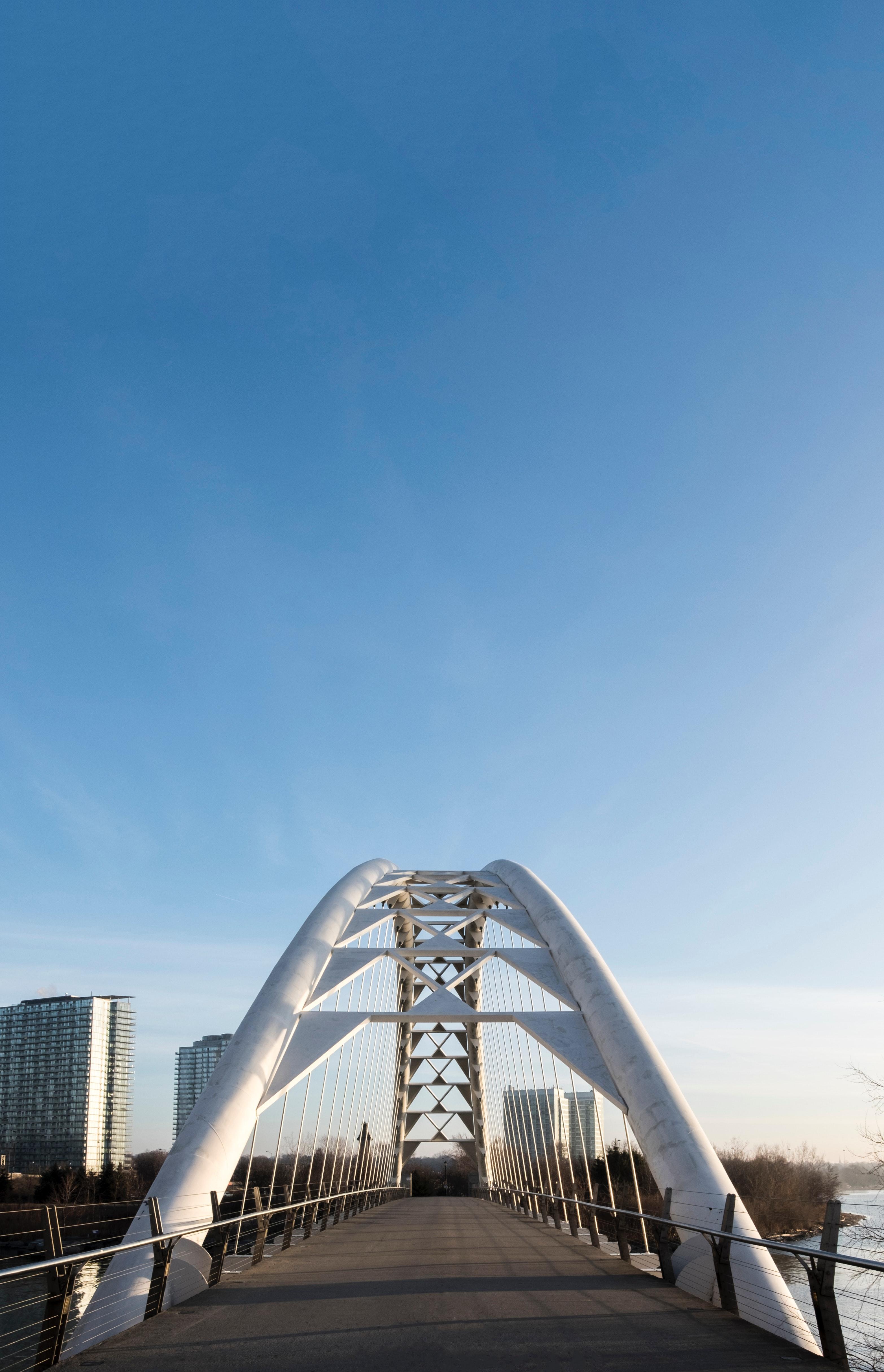 White bridge under blue sky photo