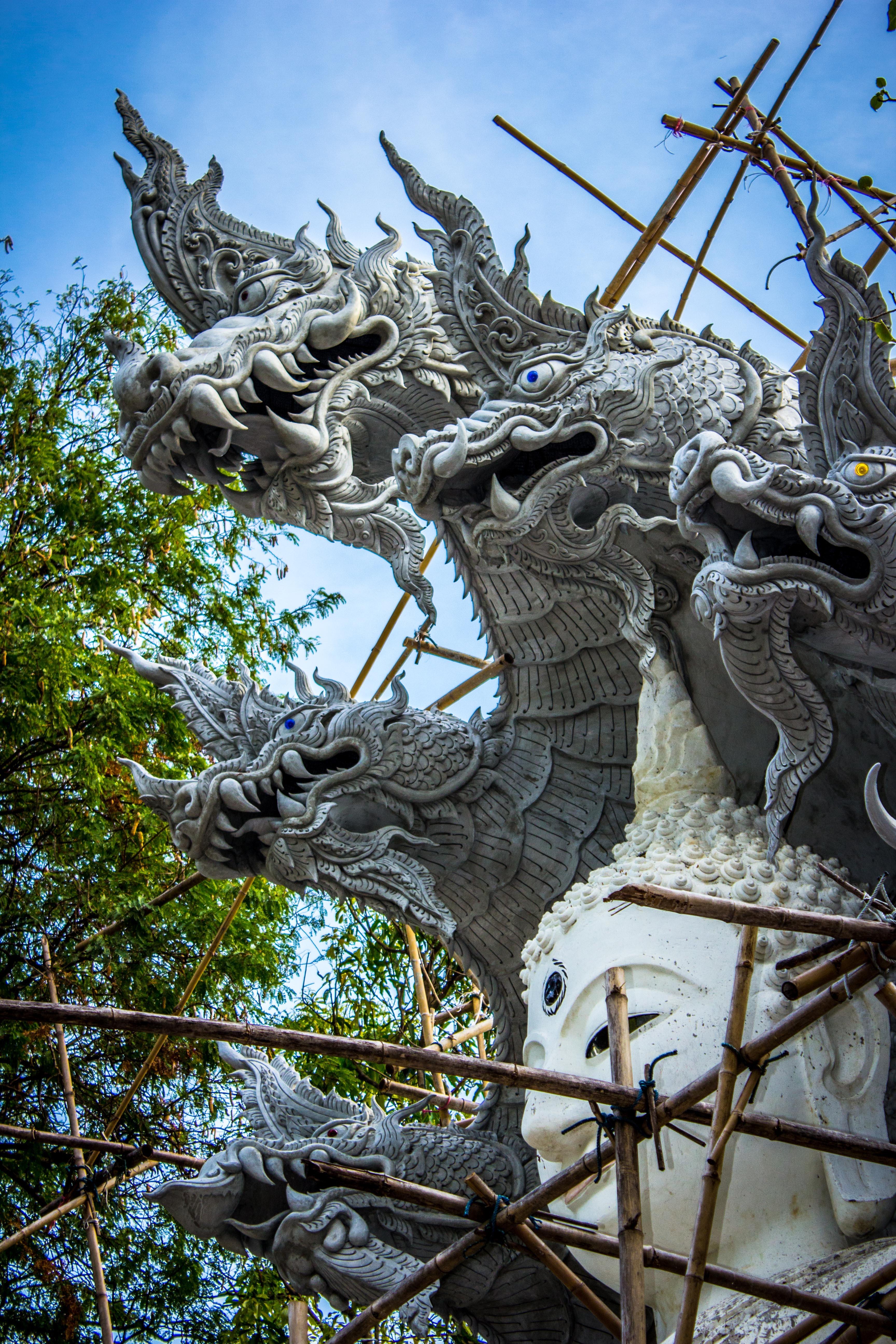 White buddha with dragon concrete statue e photo
