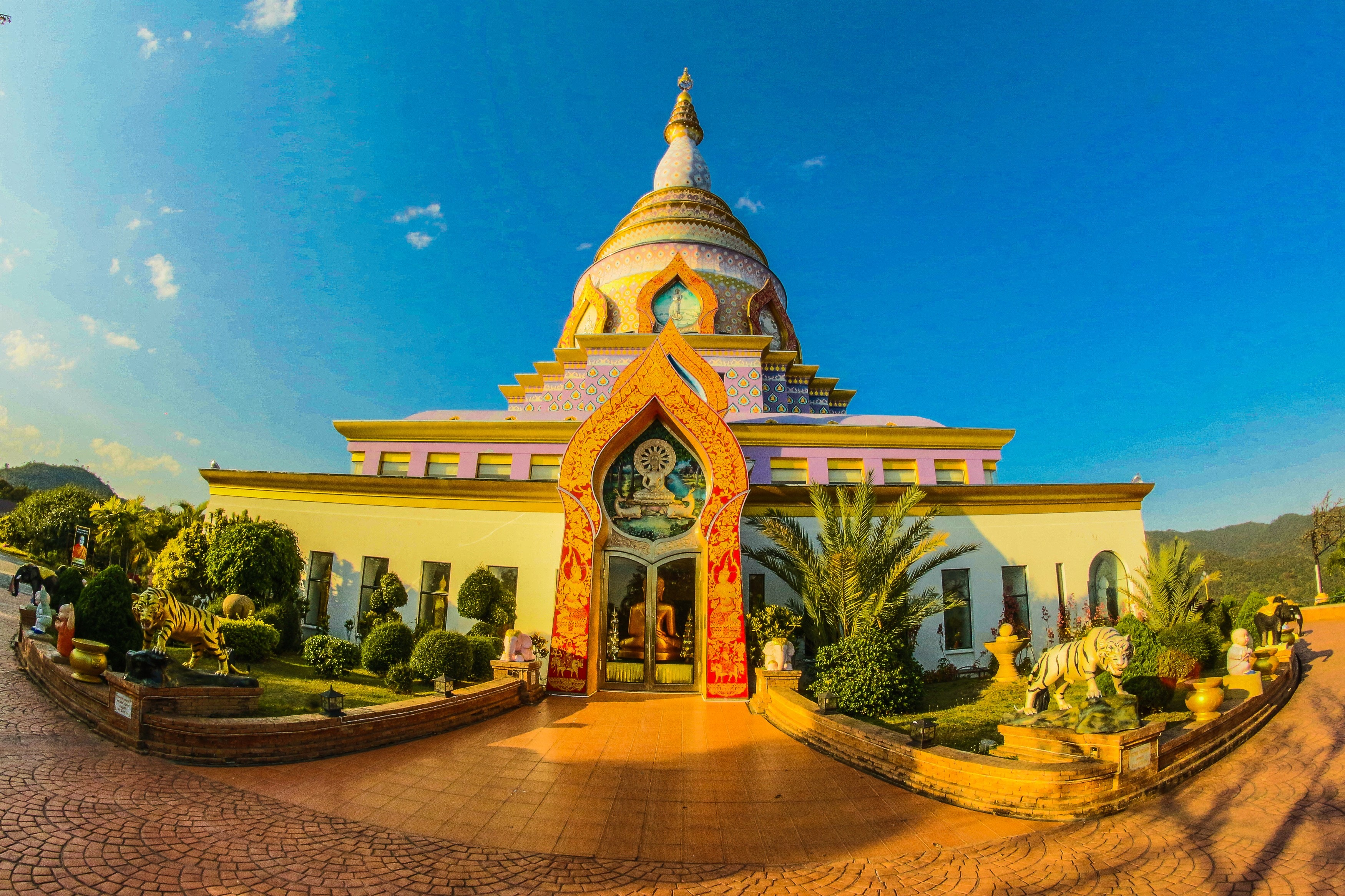 White buddhist temple with blue cloudy background photo