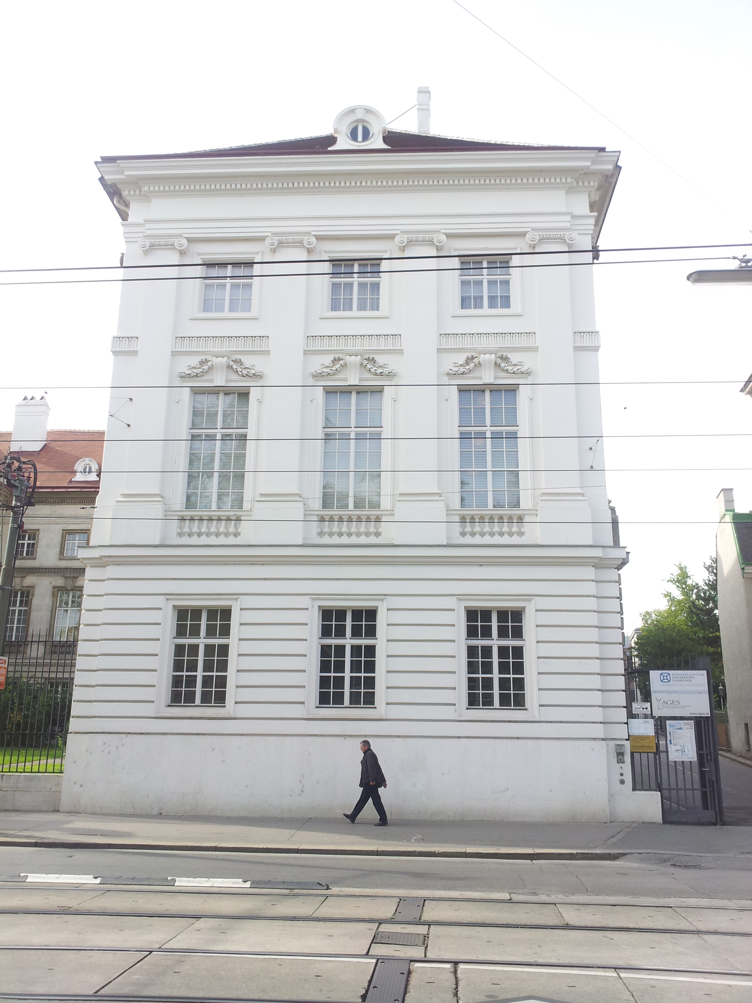 File:White building on white background, plus pedestrian.jpg ...