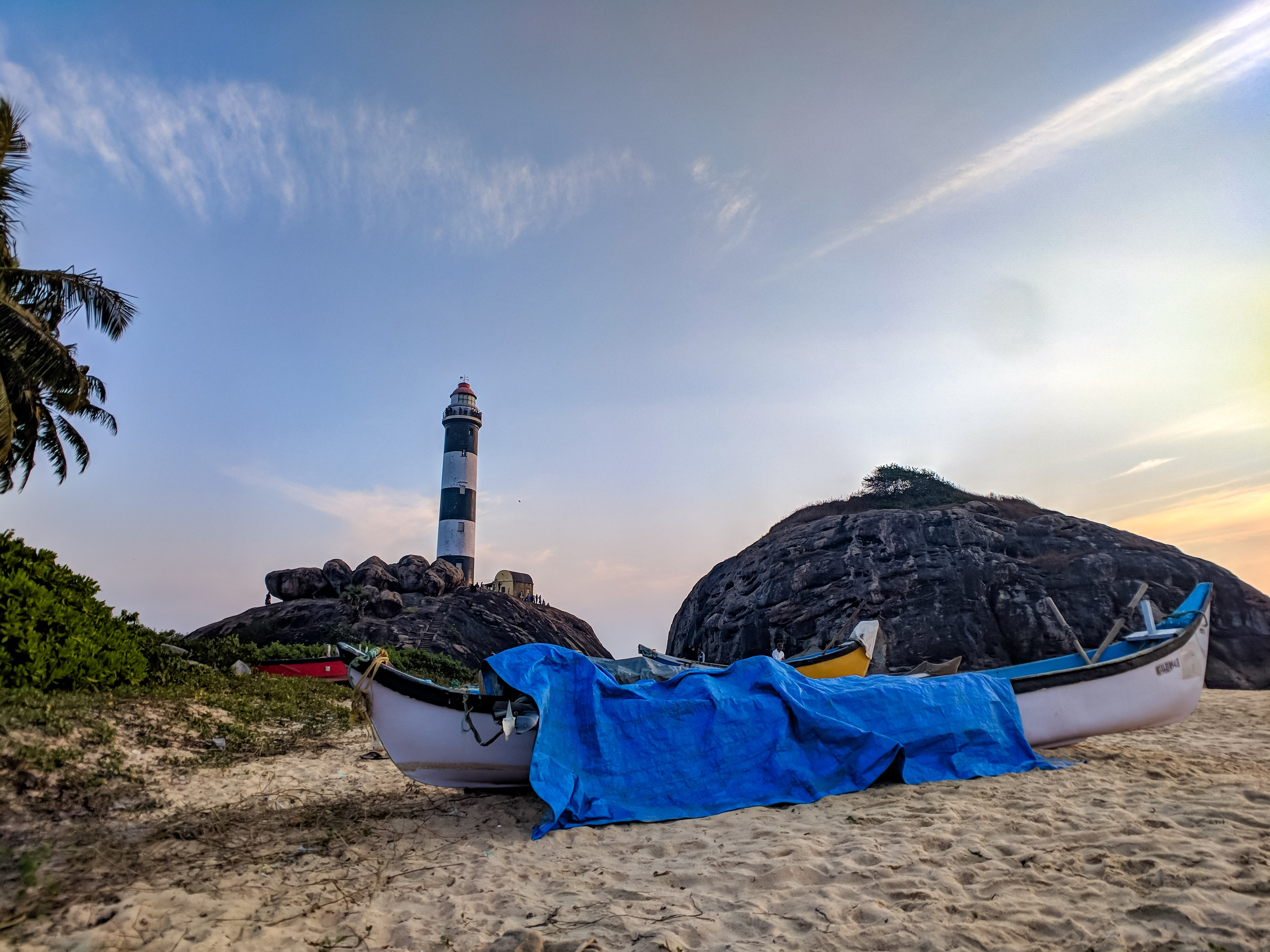 White canoe with blue cover on sand photo