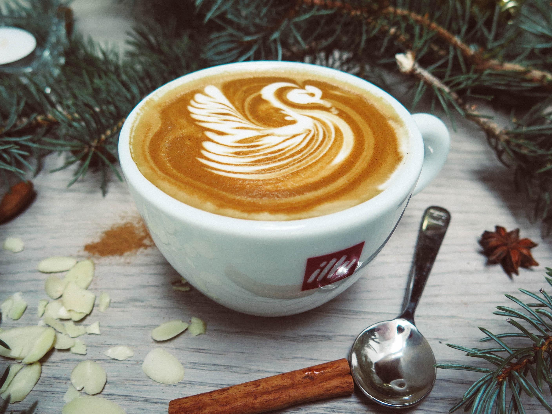 White cappuccino with swan cream design photo