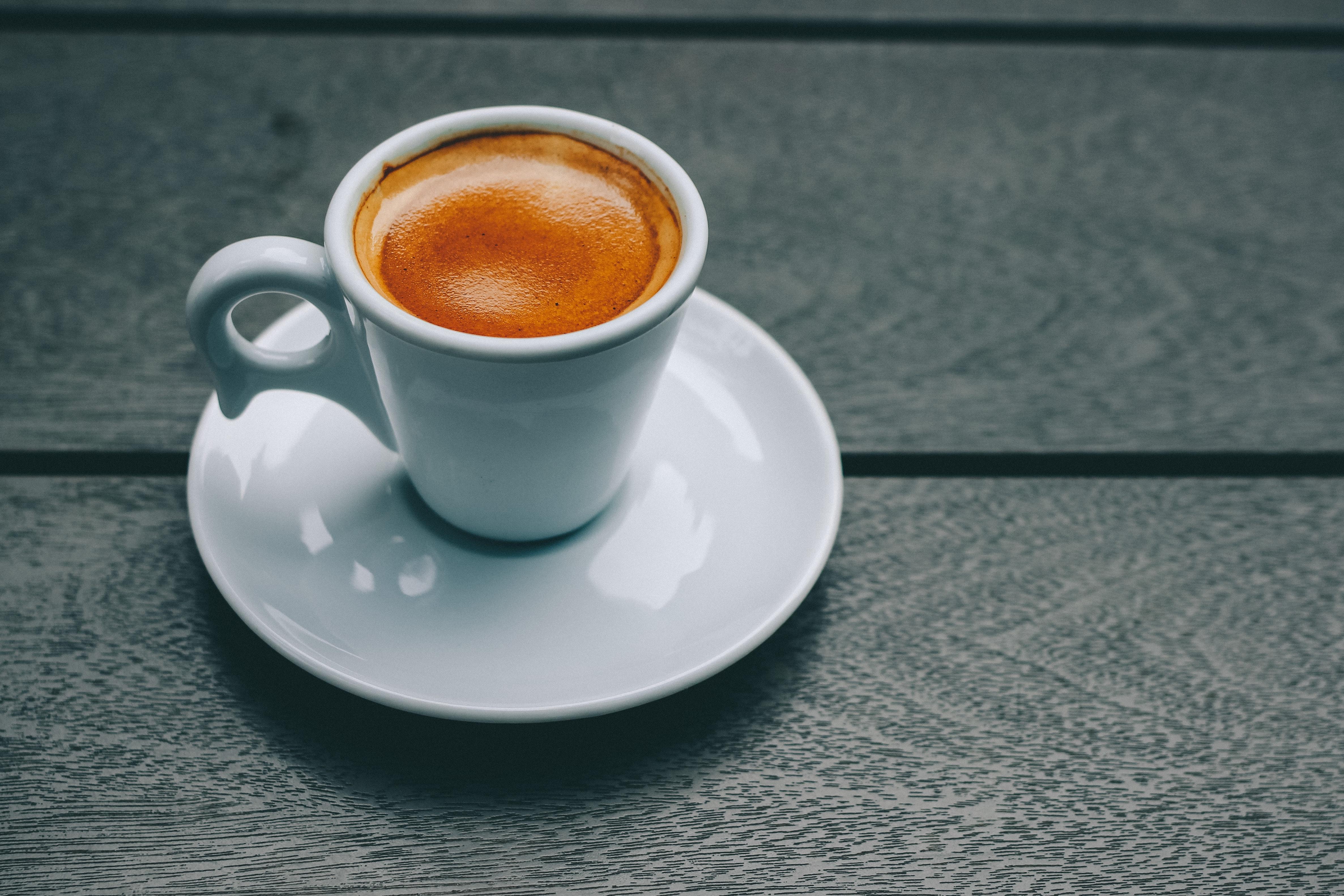 White ceramic mug and saucer photo