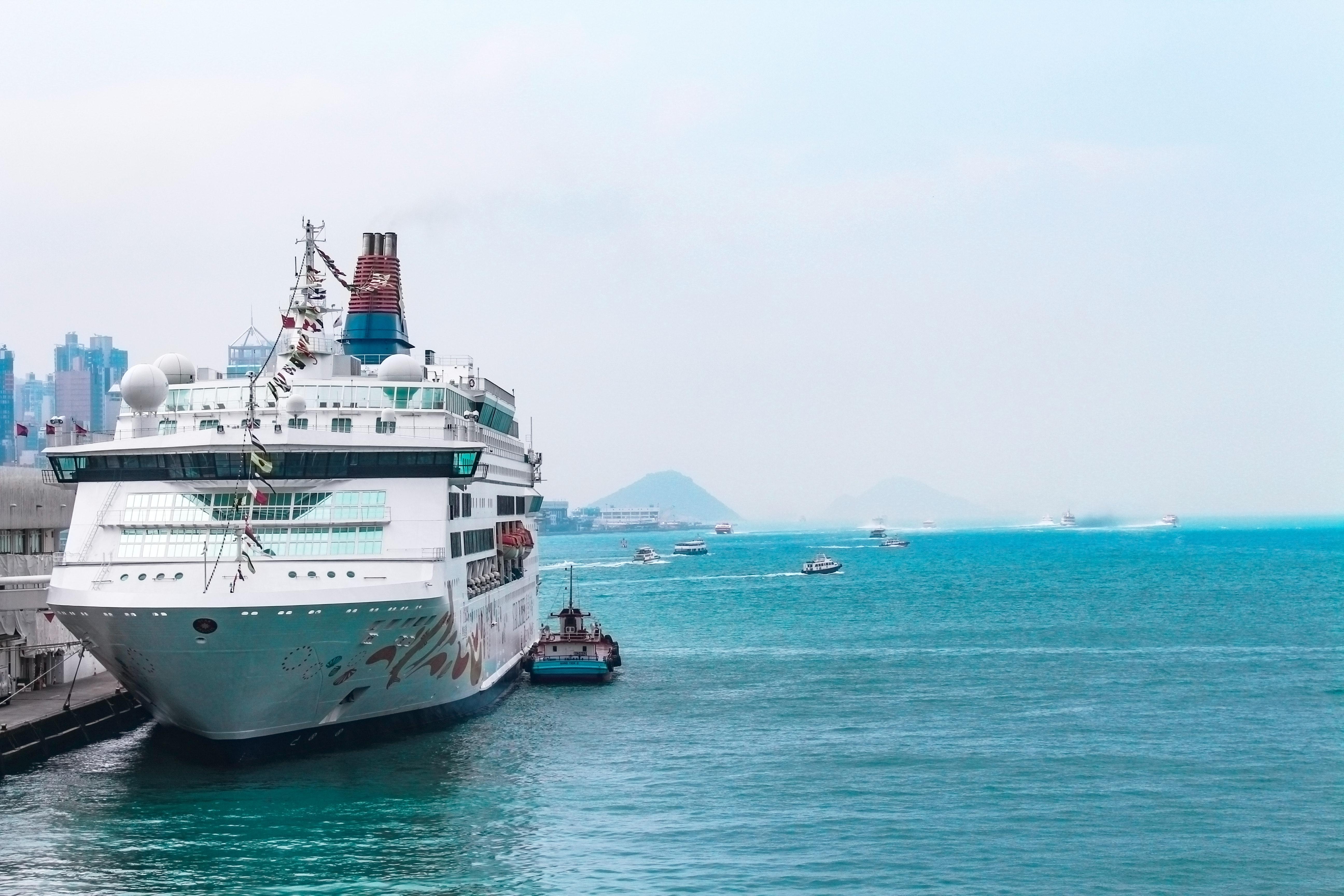 White cruise ship docking in port photo