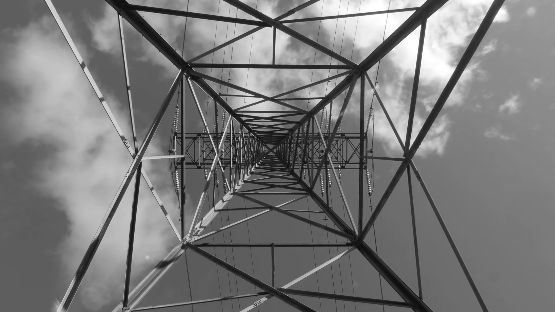Underneath a hydro-electric tower, looking up. Time lapse clouds ...