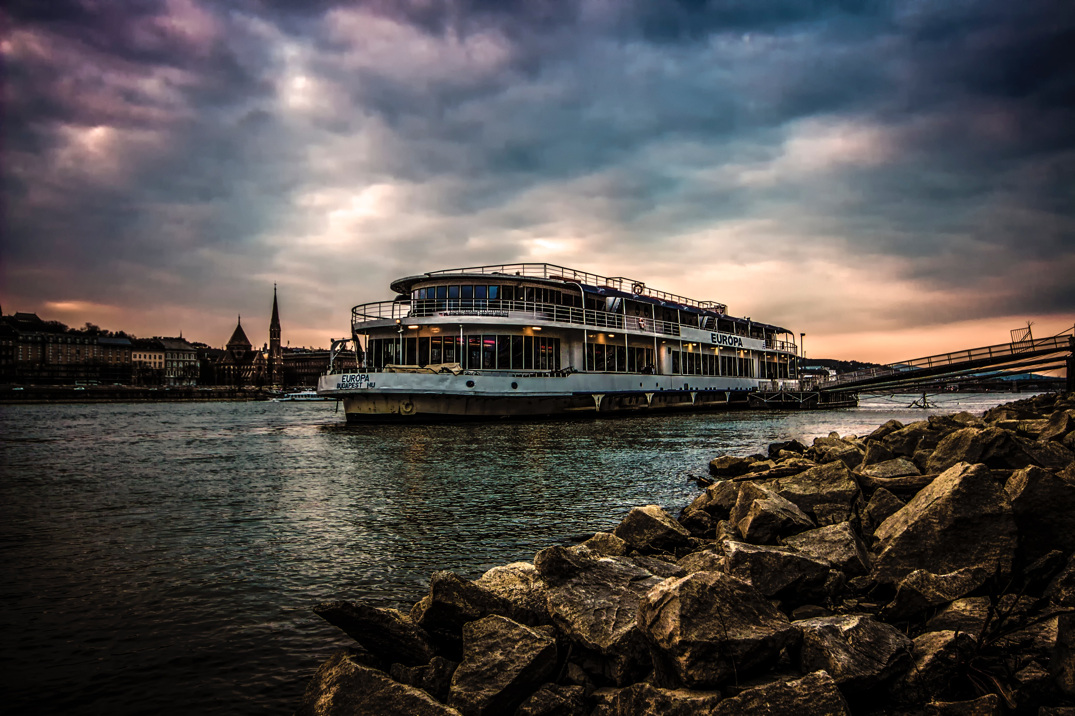 White Ferry Boat by Rocky Shore, Budapest, City, Cityscape, Clouds, HQ Photo