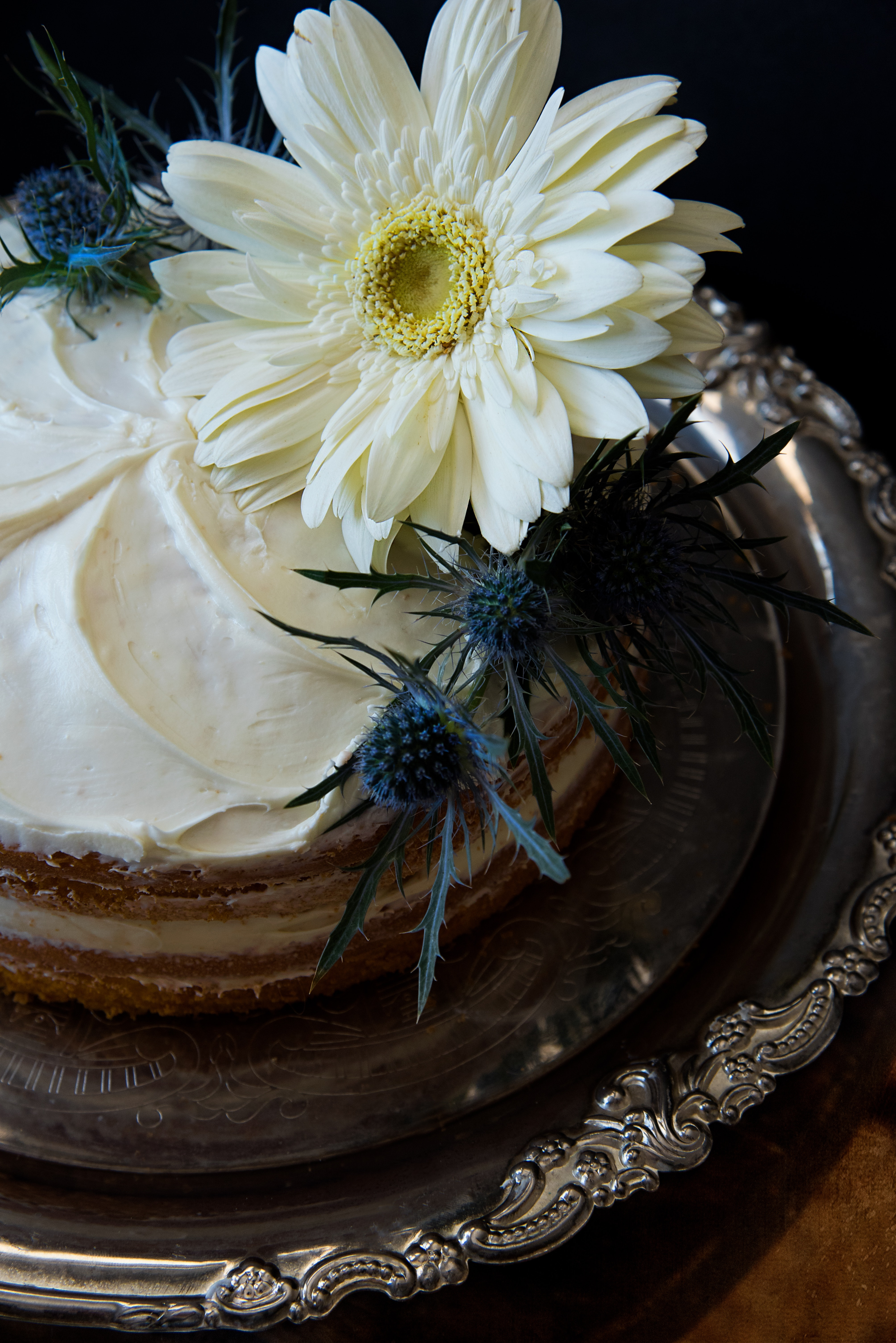 White flowers on round cake with white cream photo
