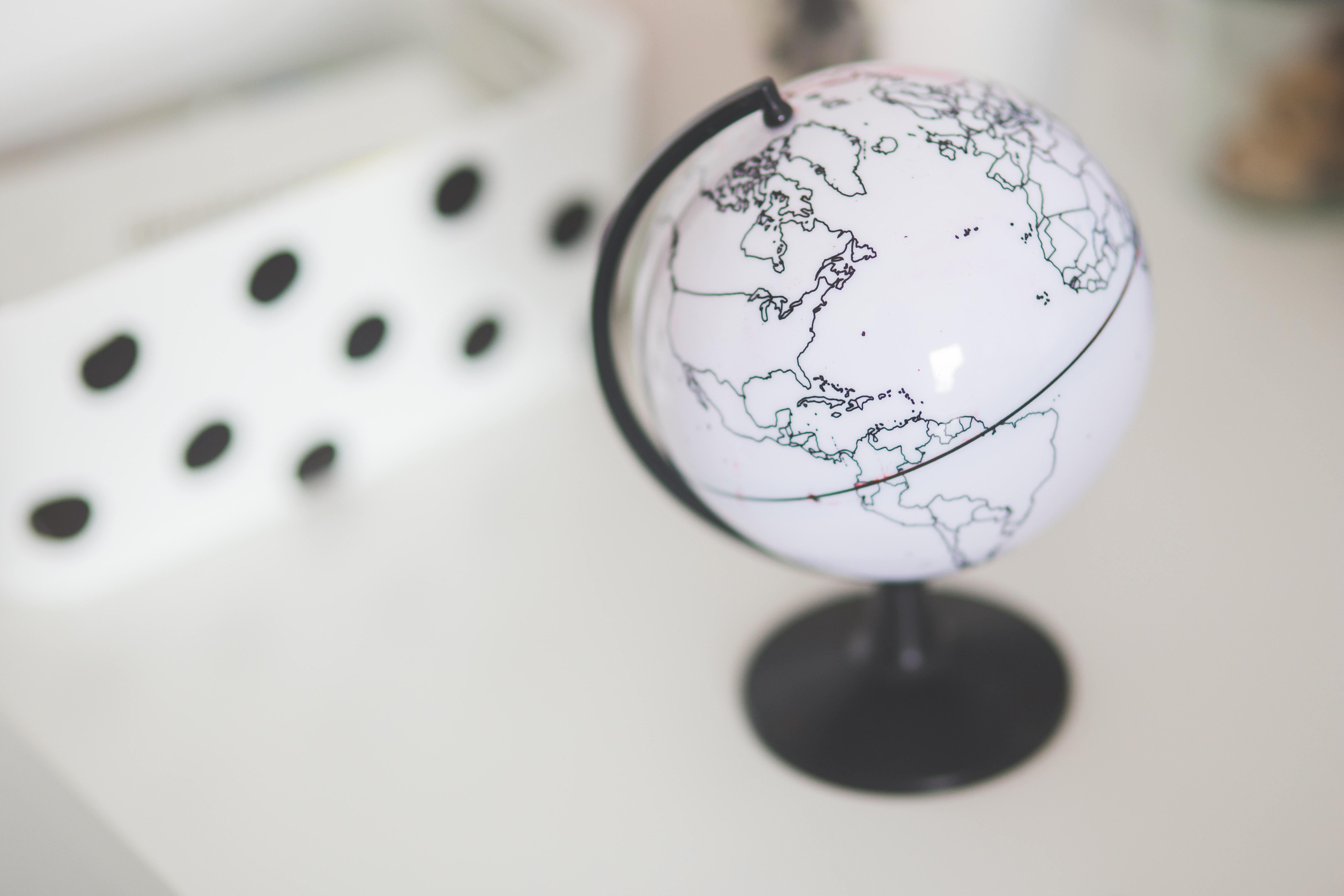 White globe on a desk photo