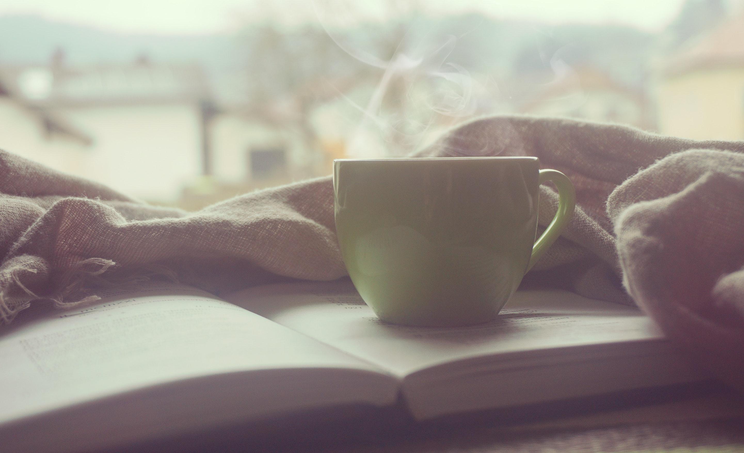 White hot mug on book near linen photo