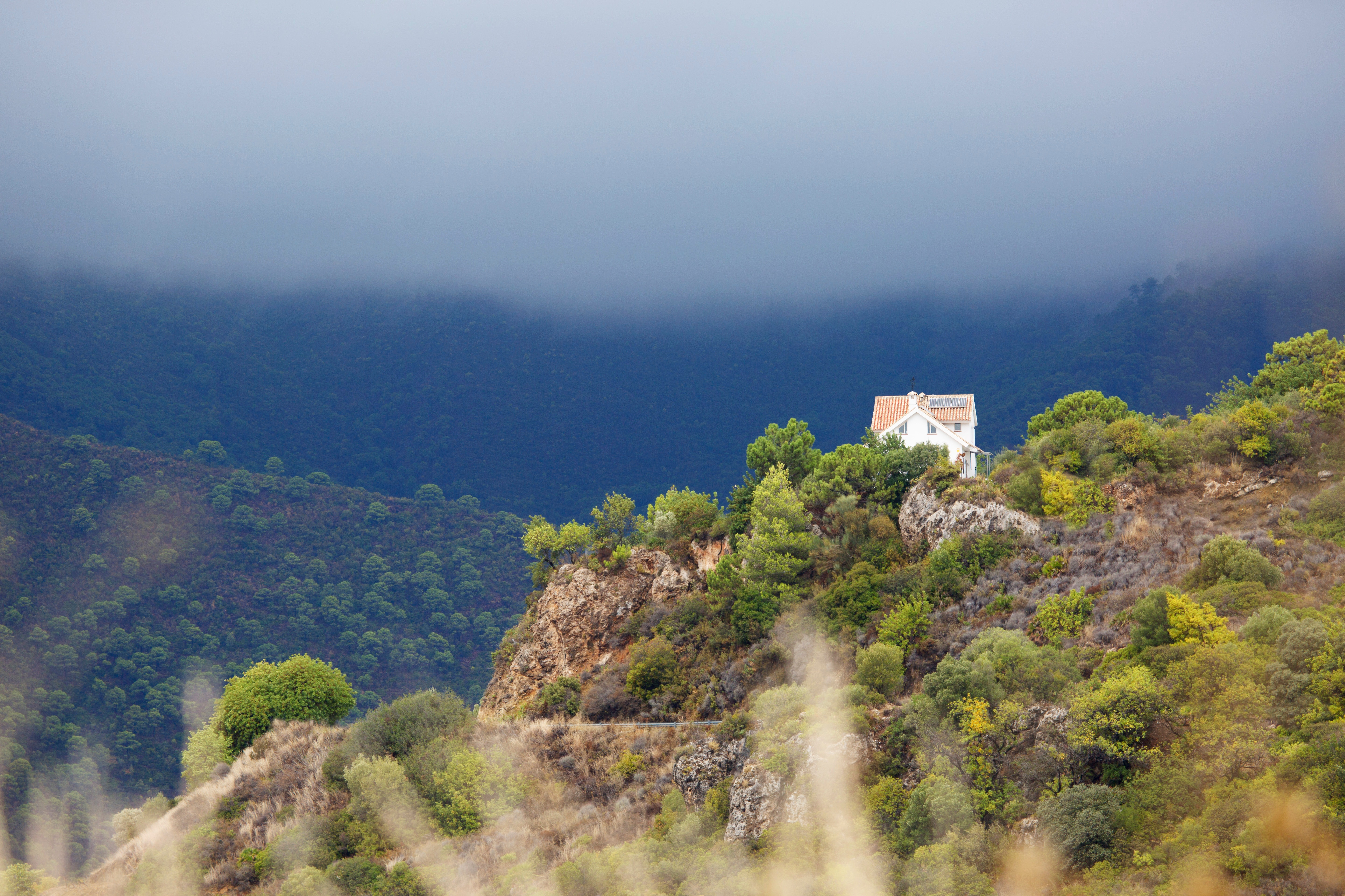 White house on mountain during cloudy day photo