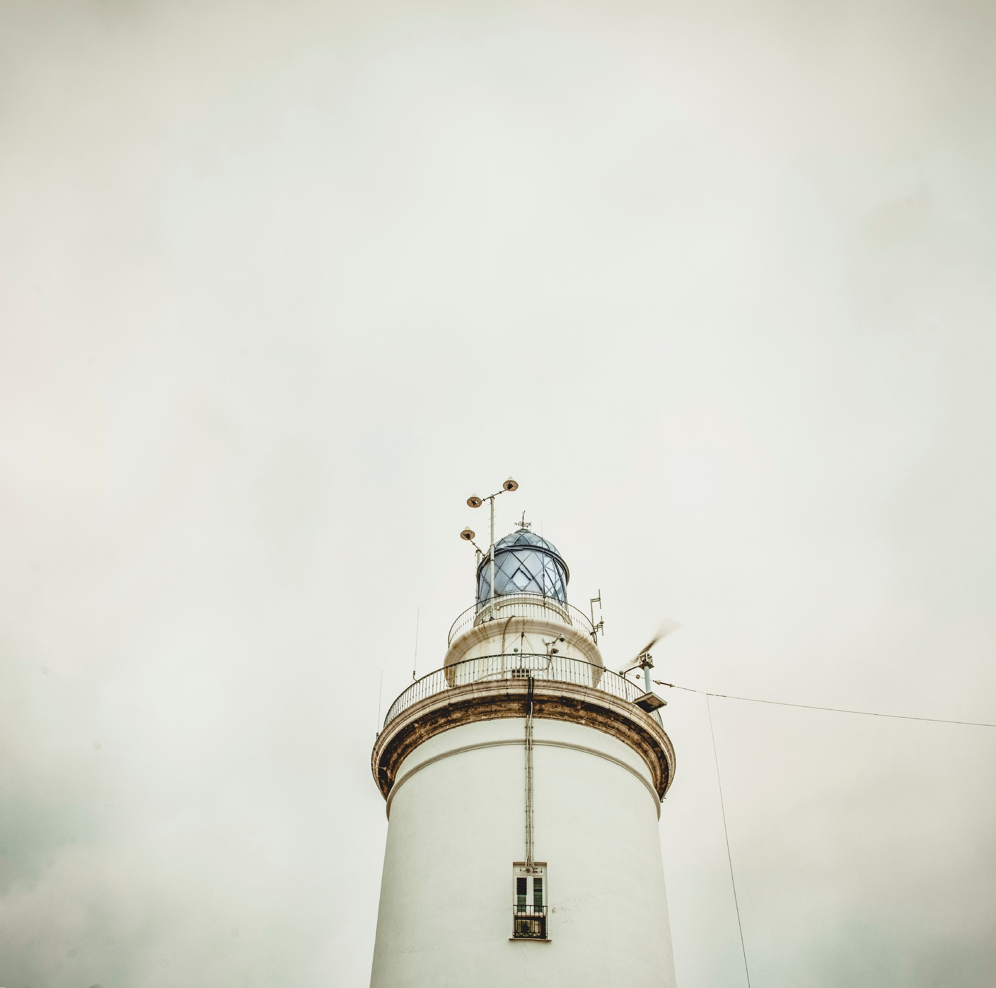 White light house under white sky photo