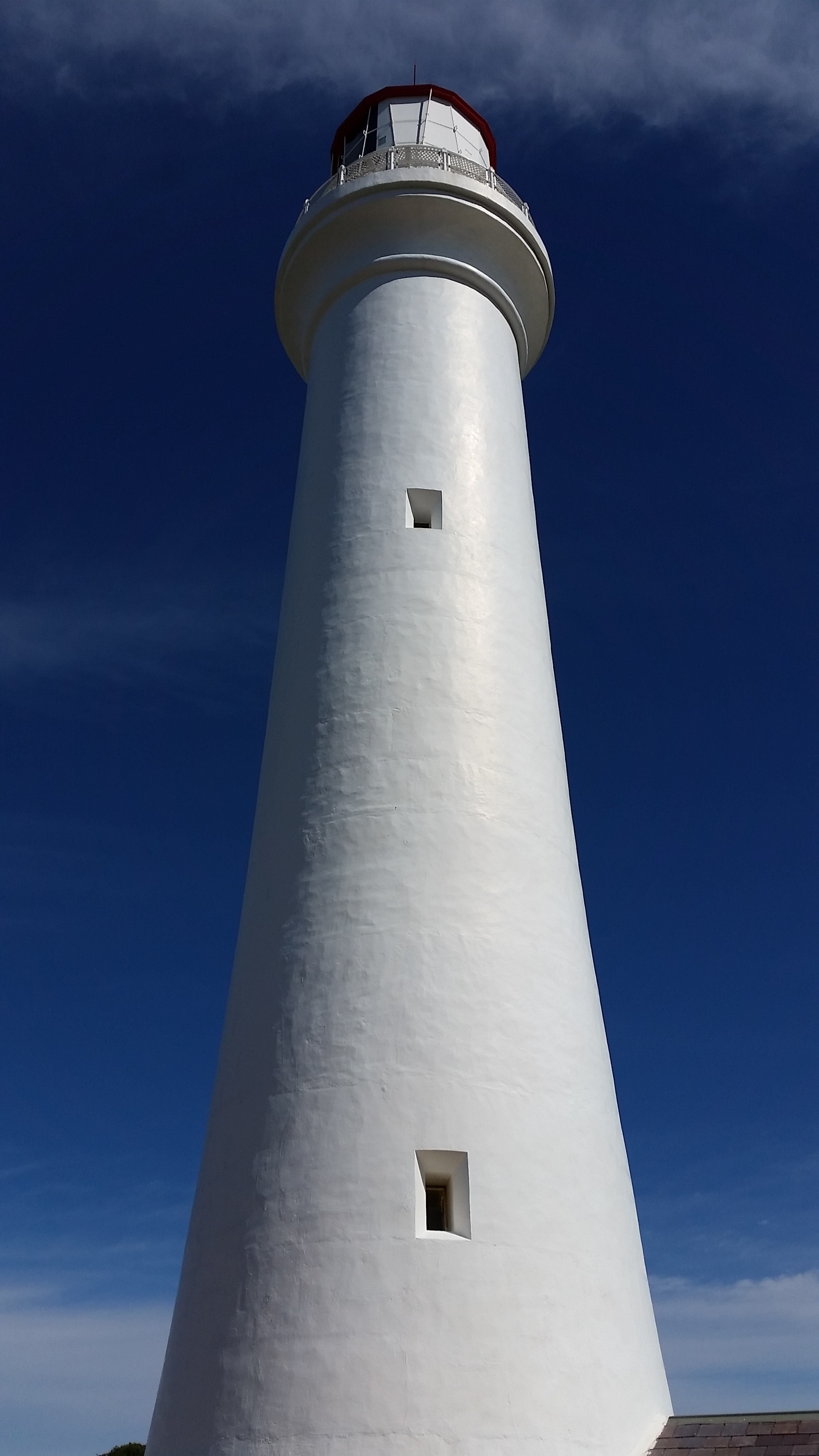 White lighthouse in low angle photography
