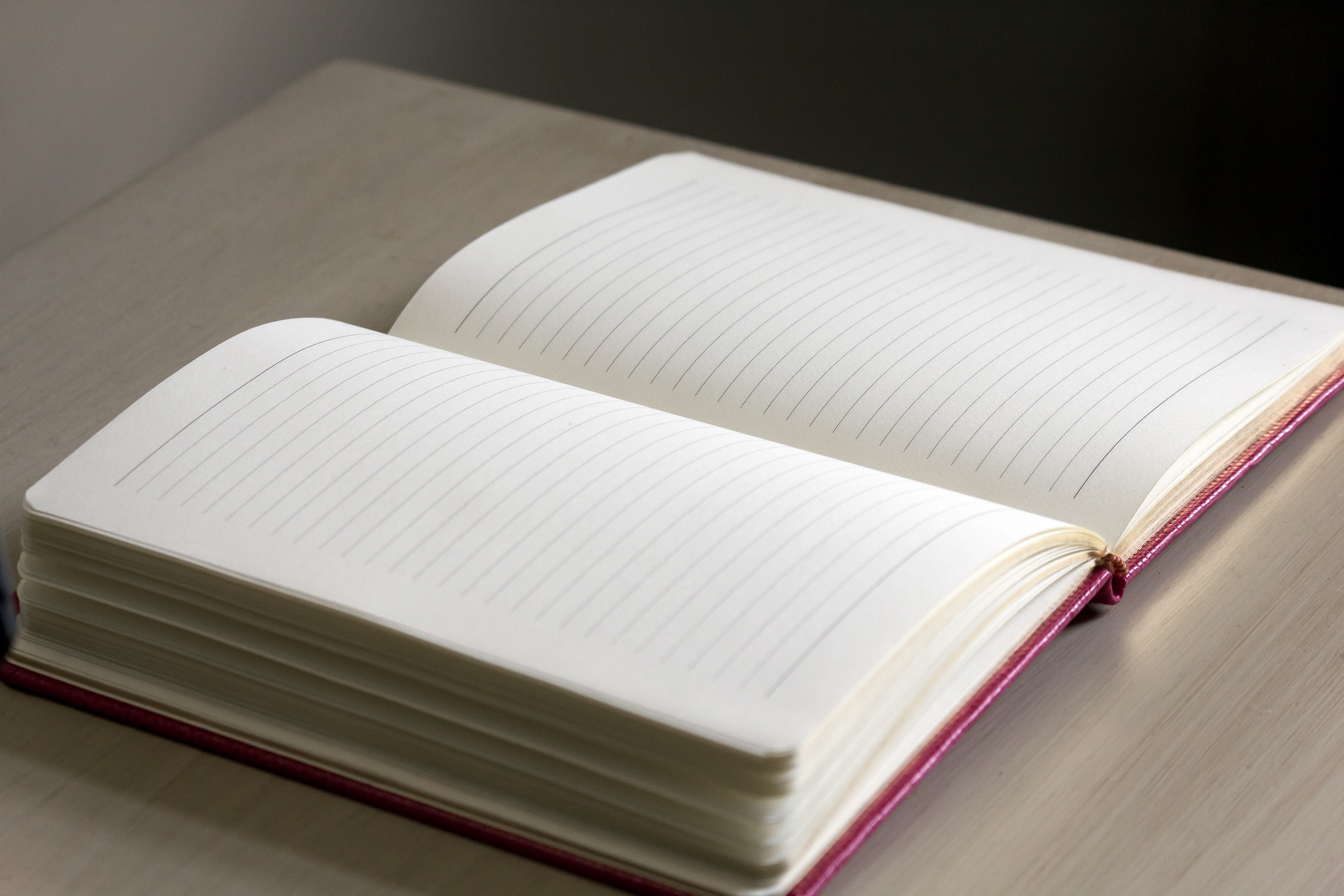 White lined notebook on gray table photo