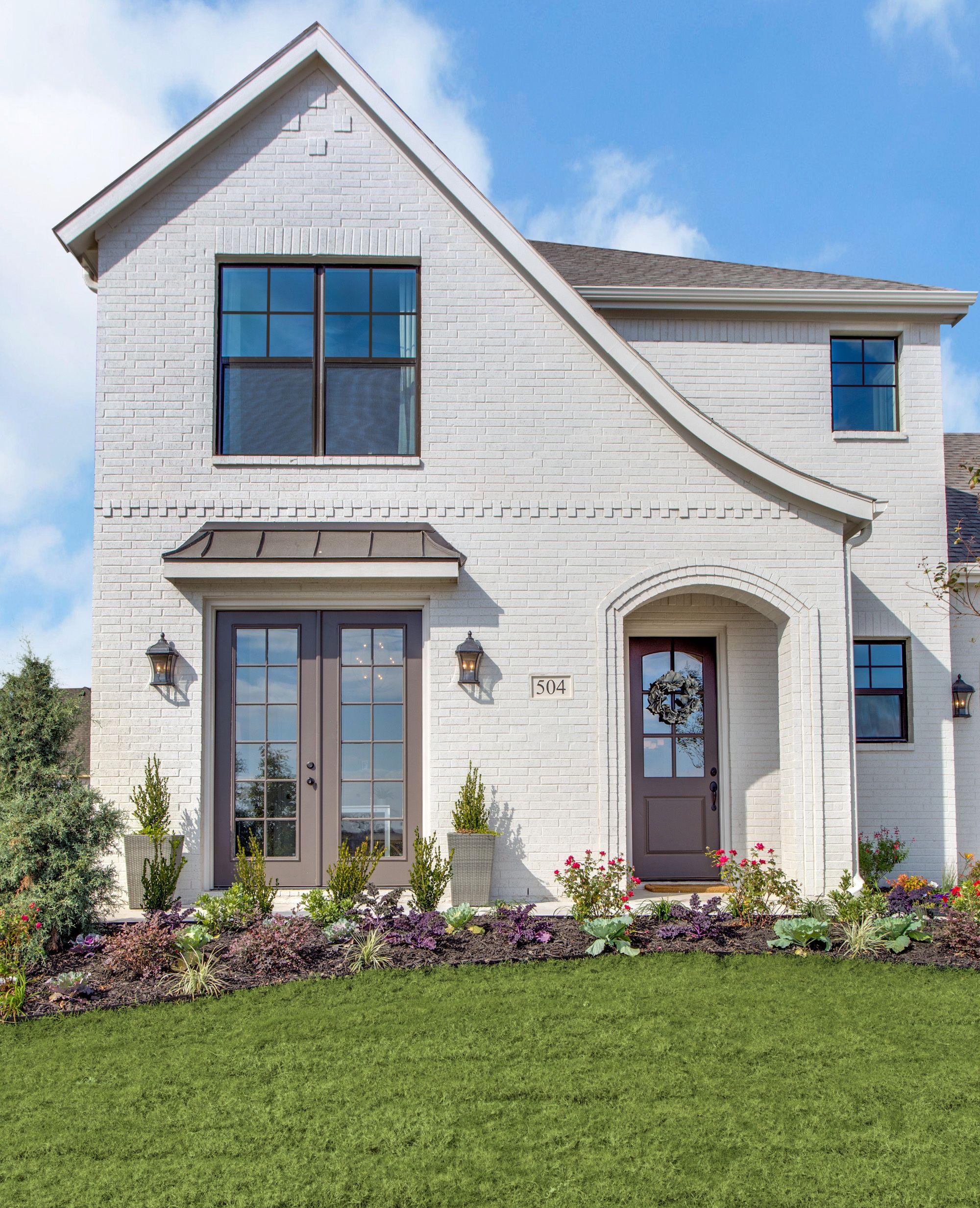 Tudor Home. White Painted Brick Tudor. Bronze Windows. Does it get ...