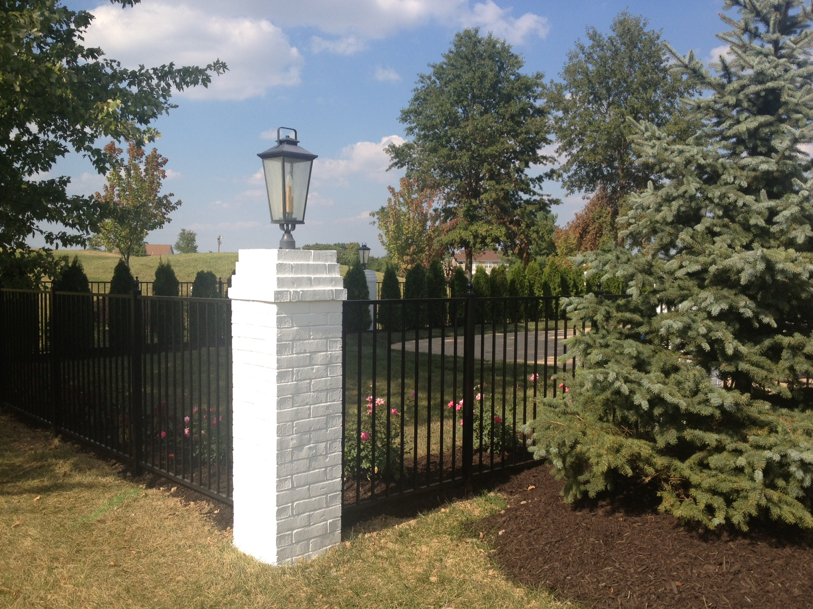 Painted white brick column with lantern - fence. | Fence | Pinterest ...