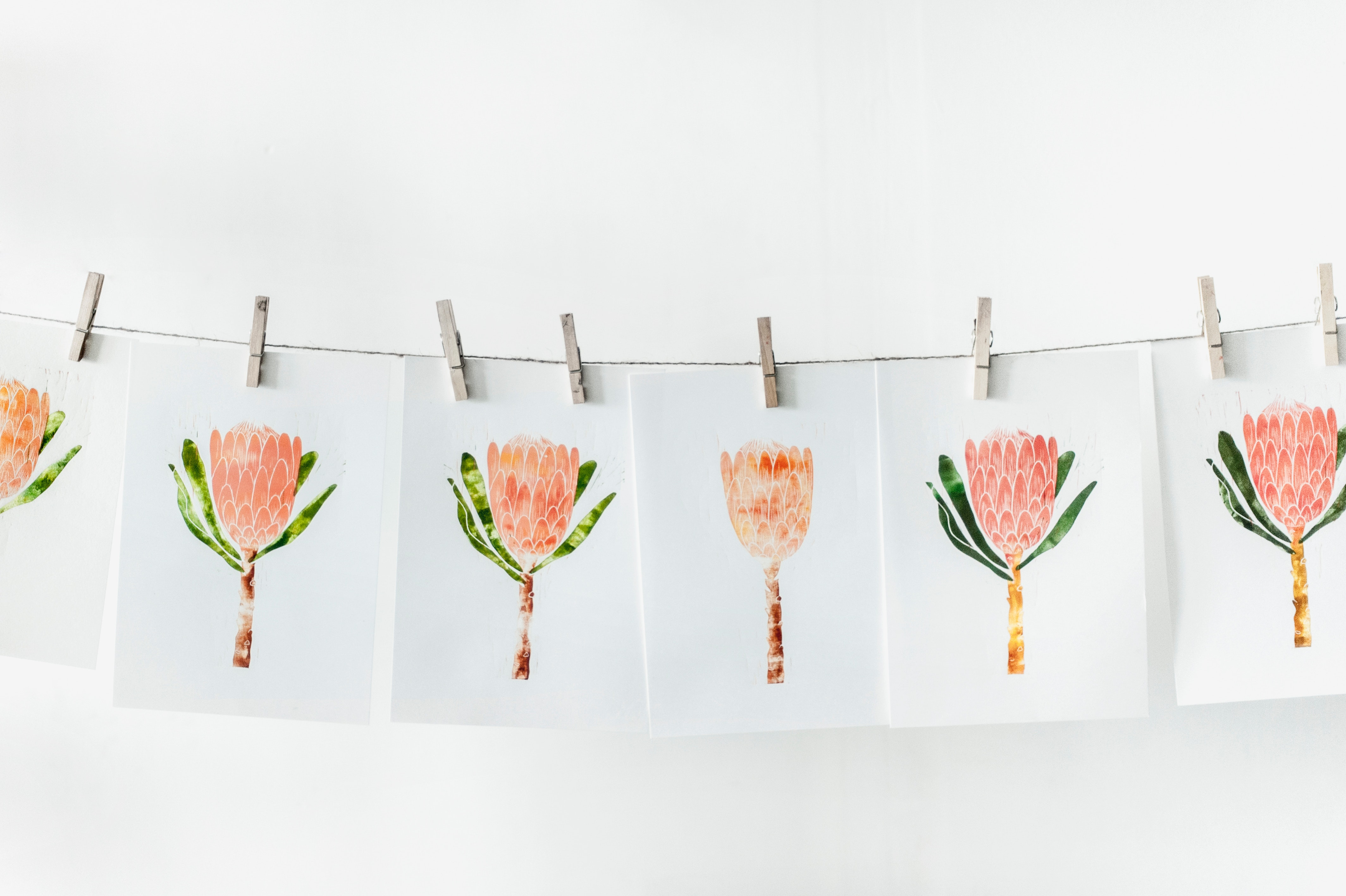 Free Photo White Paper With Orange Flower Print Lot Illustration
