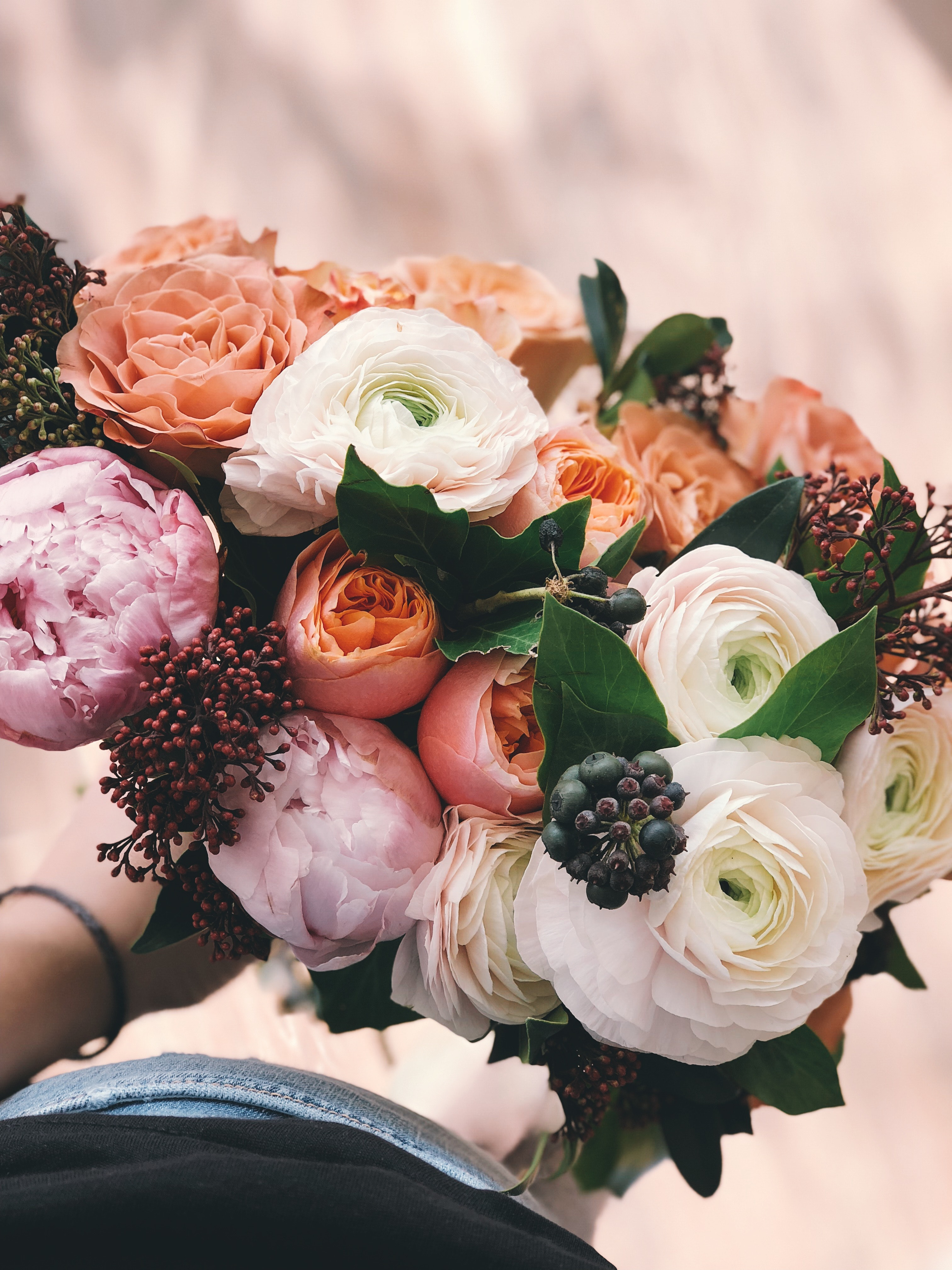 White, pink, and orange rose bouquet photo