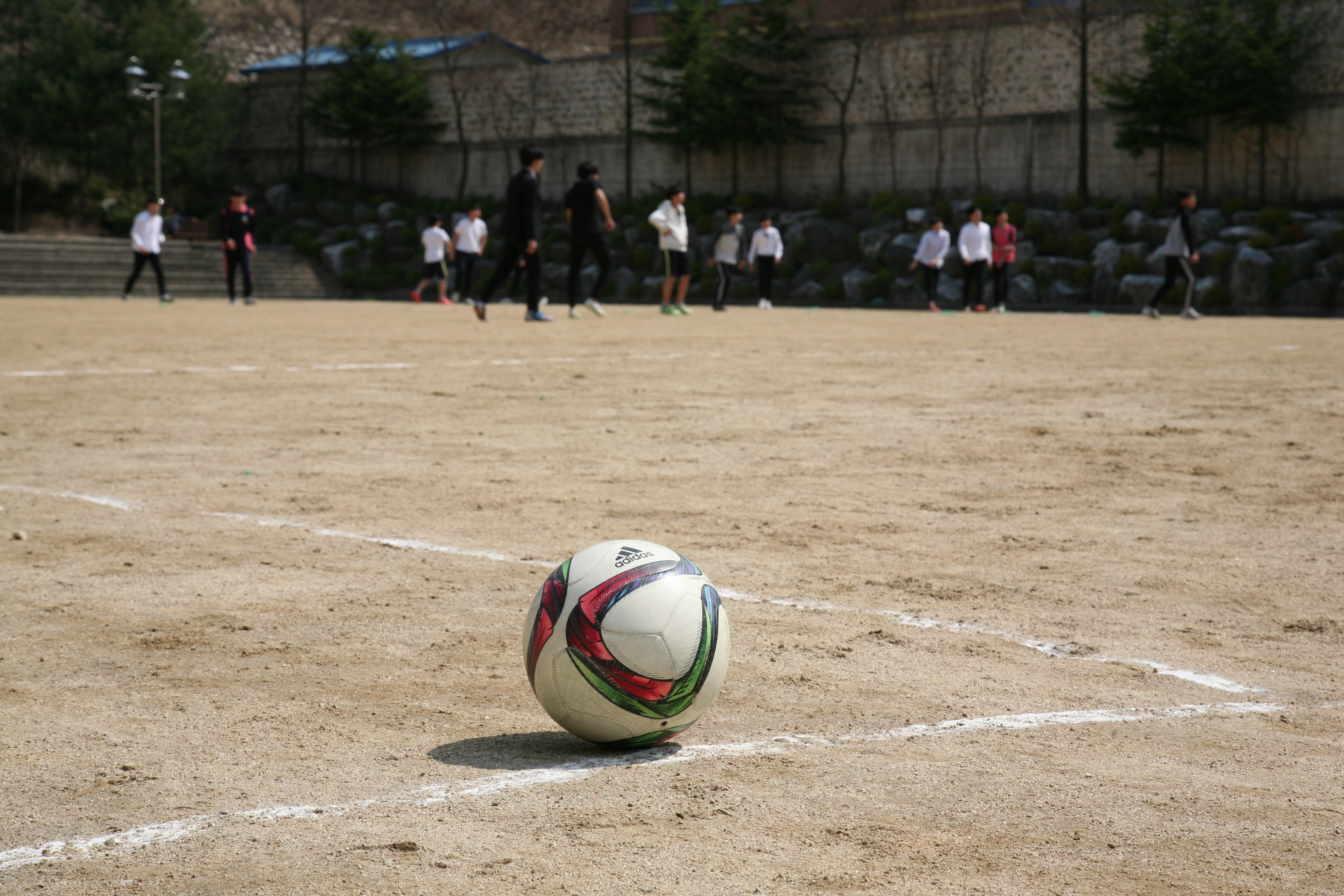 White Red and Green Ball Near Group of People Playing Soccer, Soccer, Sand, Recreation, Soccer field, HQ Photo