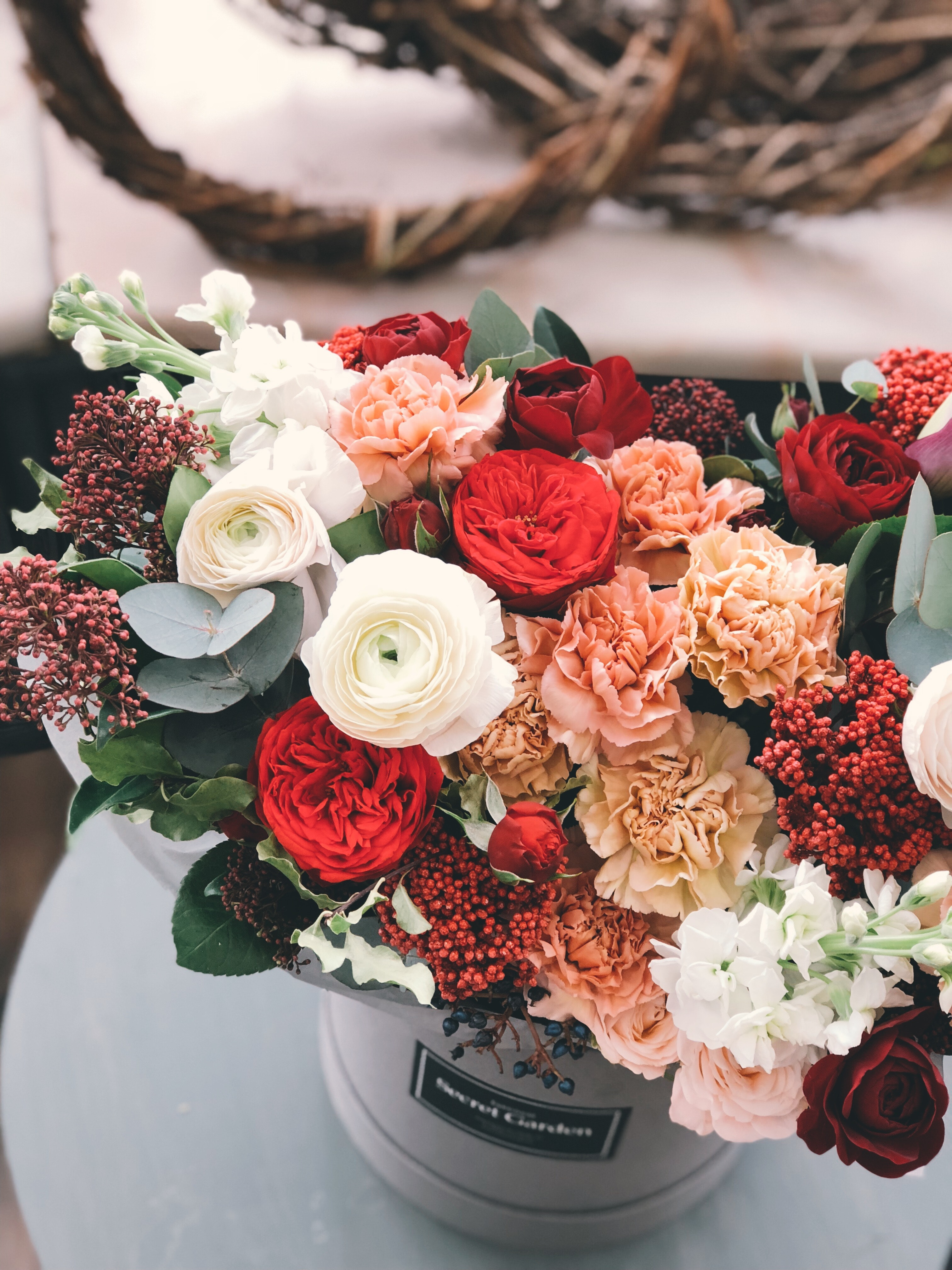 White, red, orange, and brown flowers photo