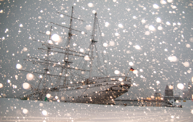 White sailing ship docked at pier photo