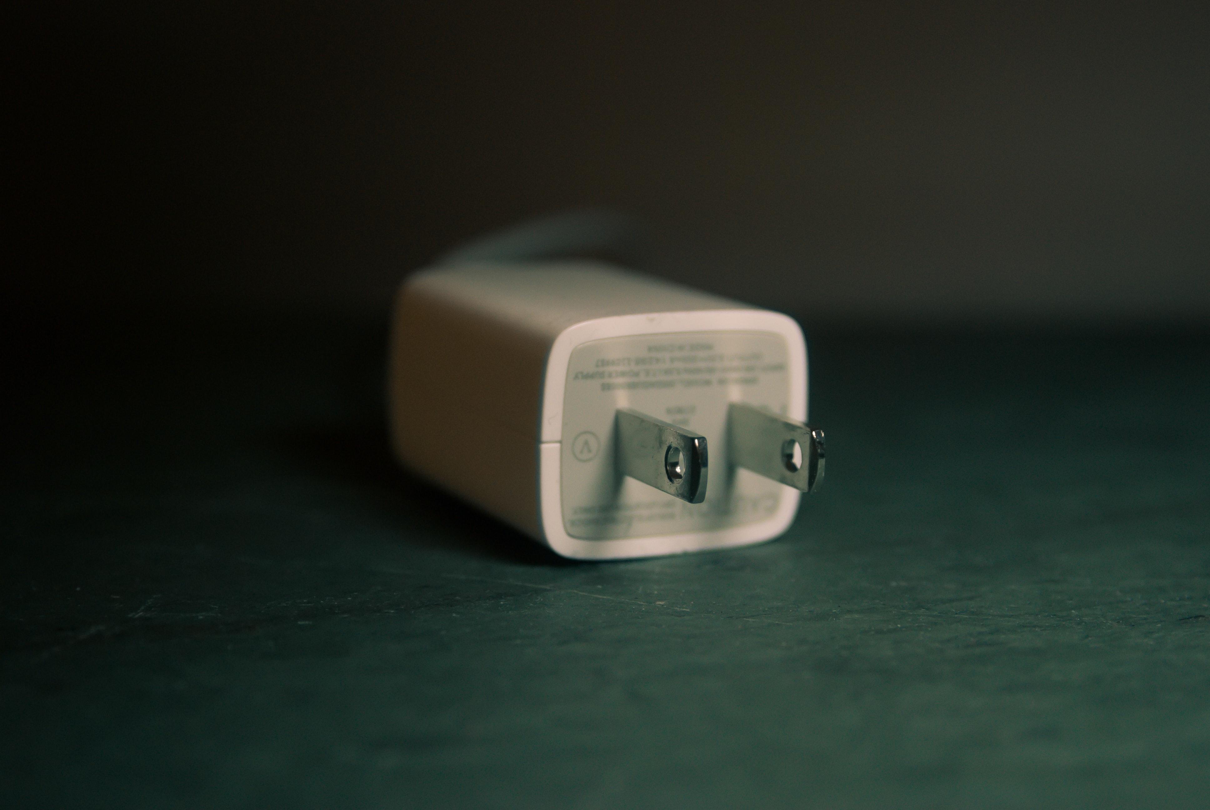 White travel adapter photo