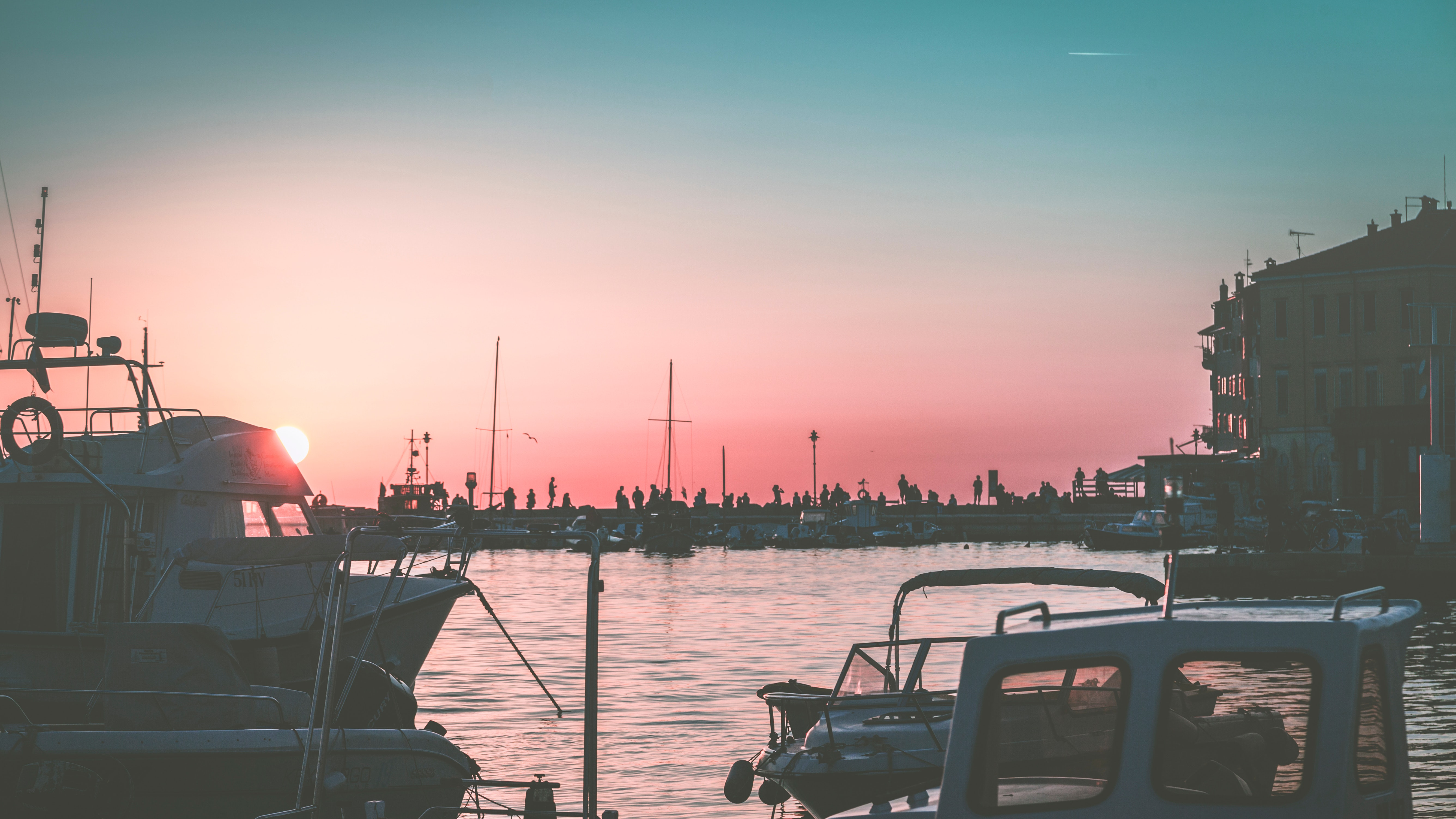 White yacht on body of water during sunset photo
