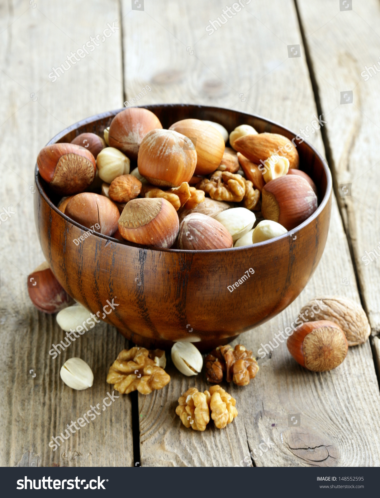 Whole walnuts on rustic old wooden table - with copyspace photo