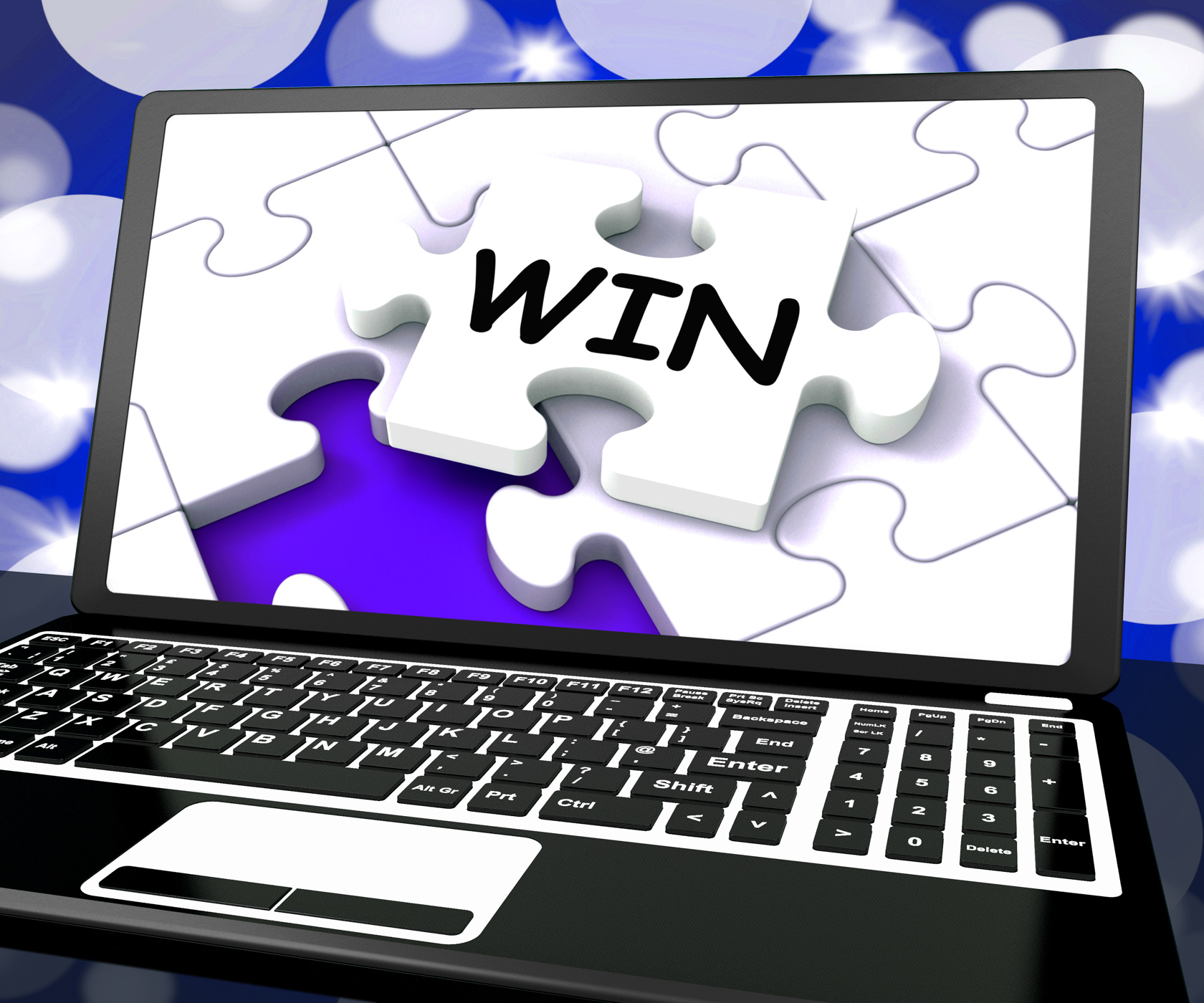 Win puzzle on laptop shows victory photo
