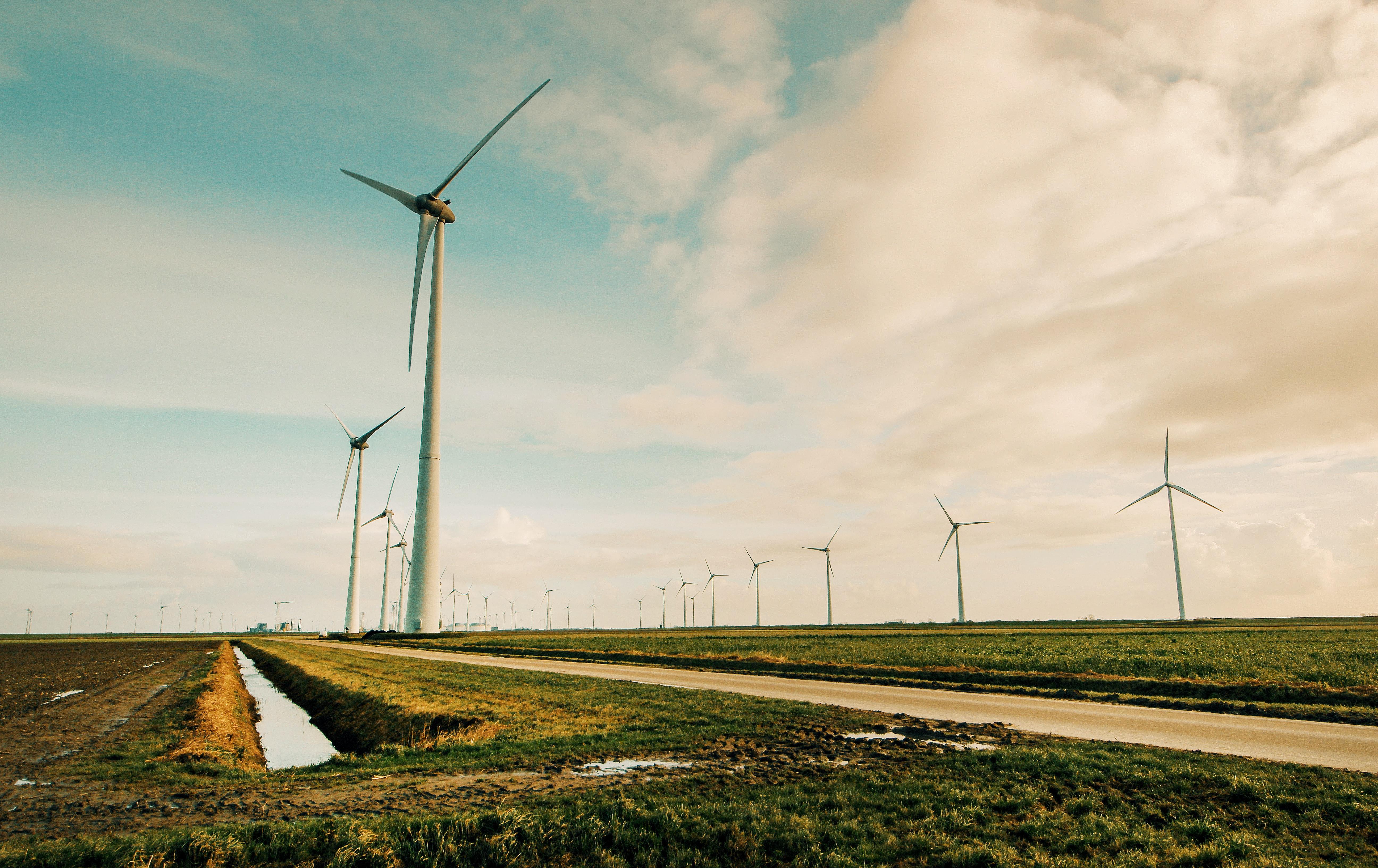 Windmill energy on green grass field photo