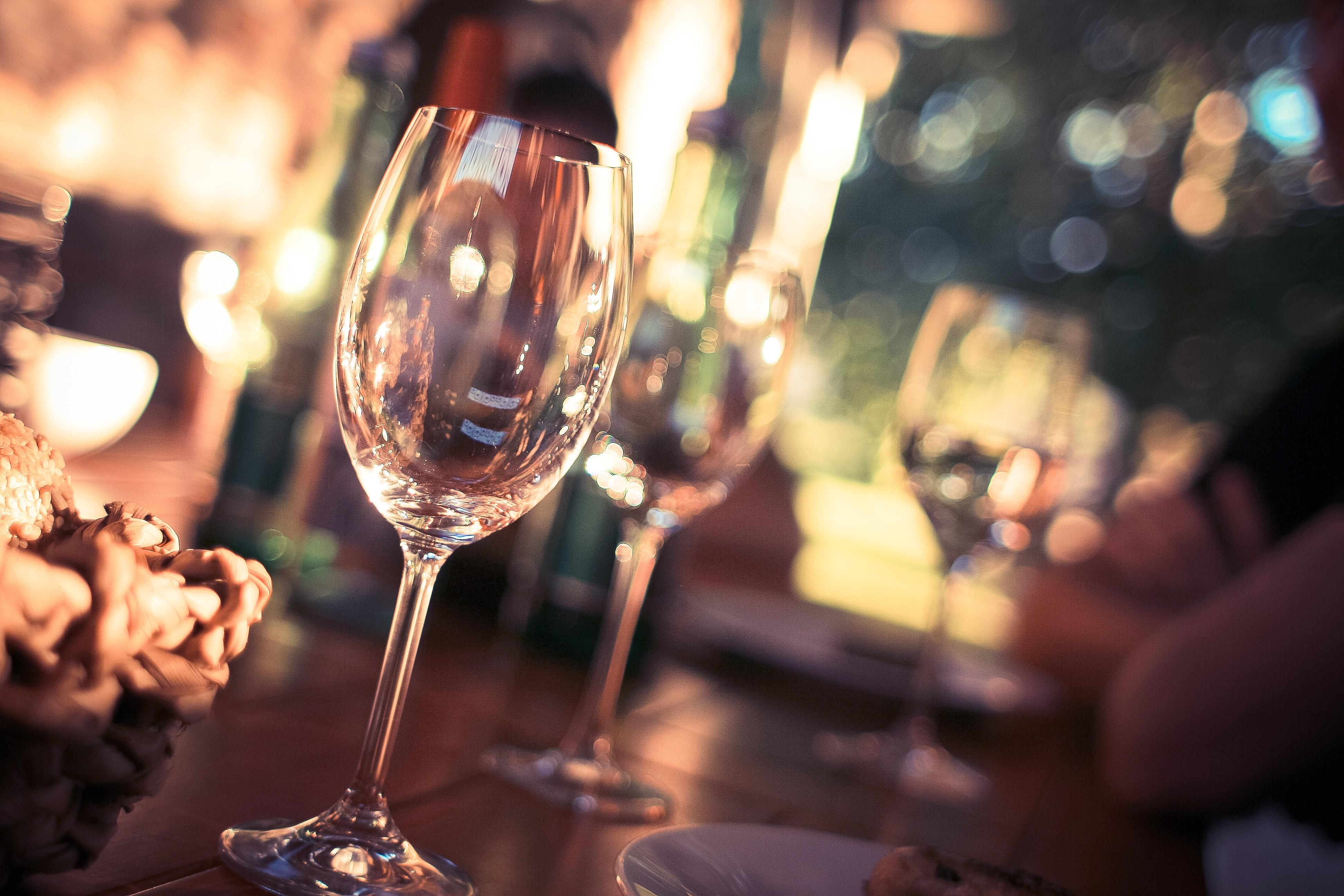 Wine glass on restaurant table photo