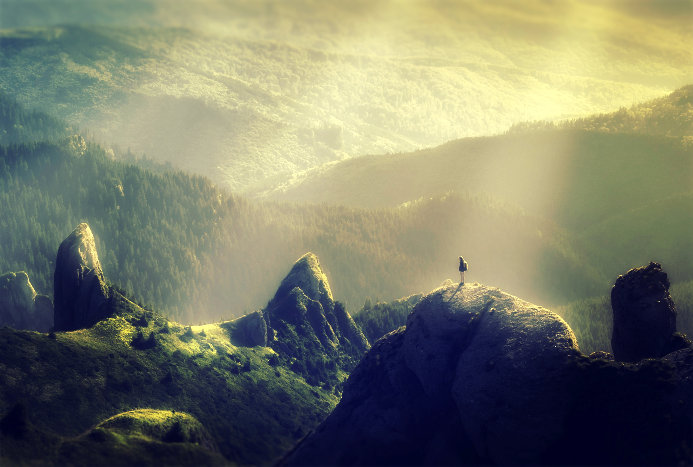 Woman alone at the top of the mountain photo