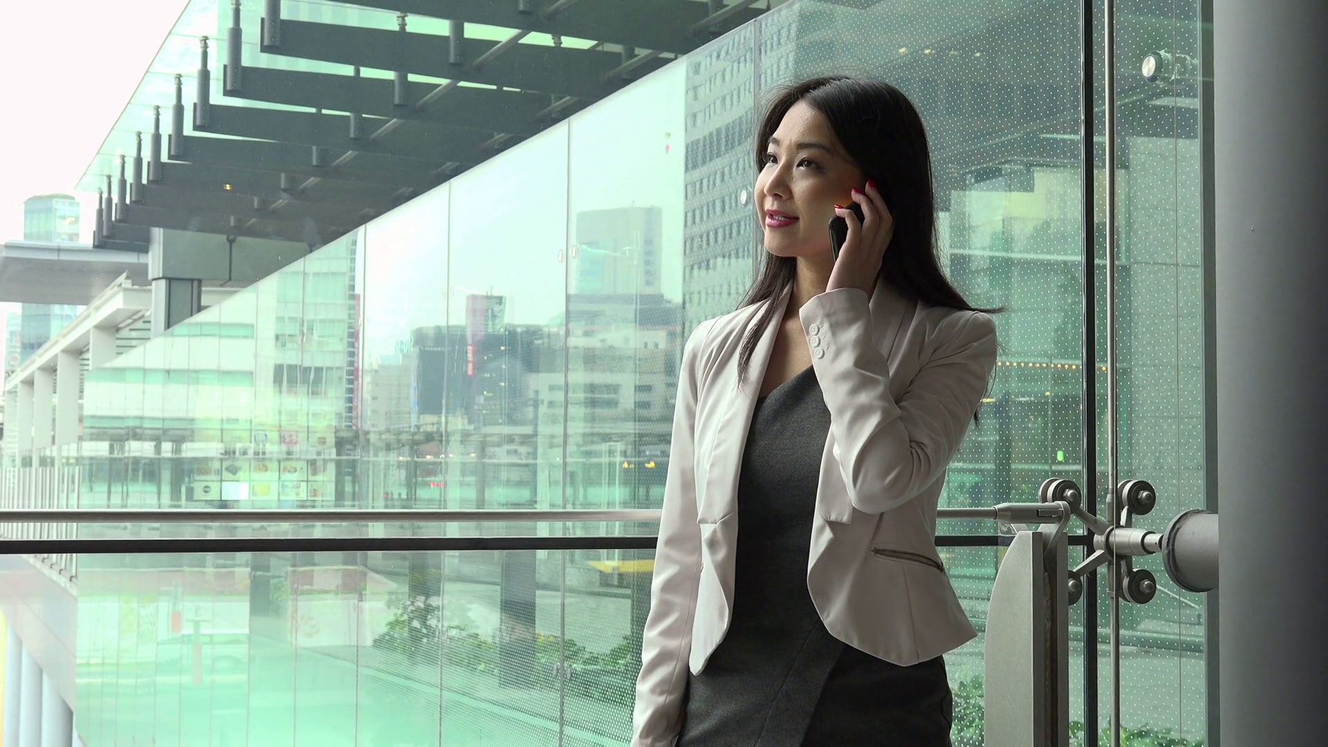 People and technology in office building. Japanese female manager ...