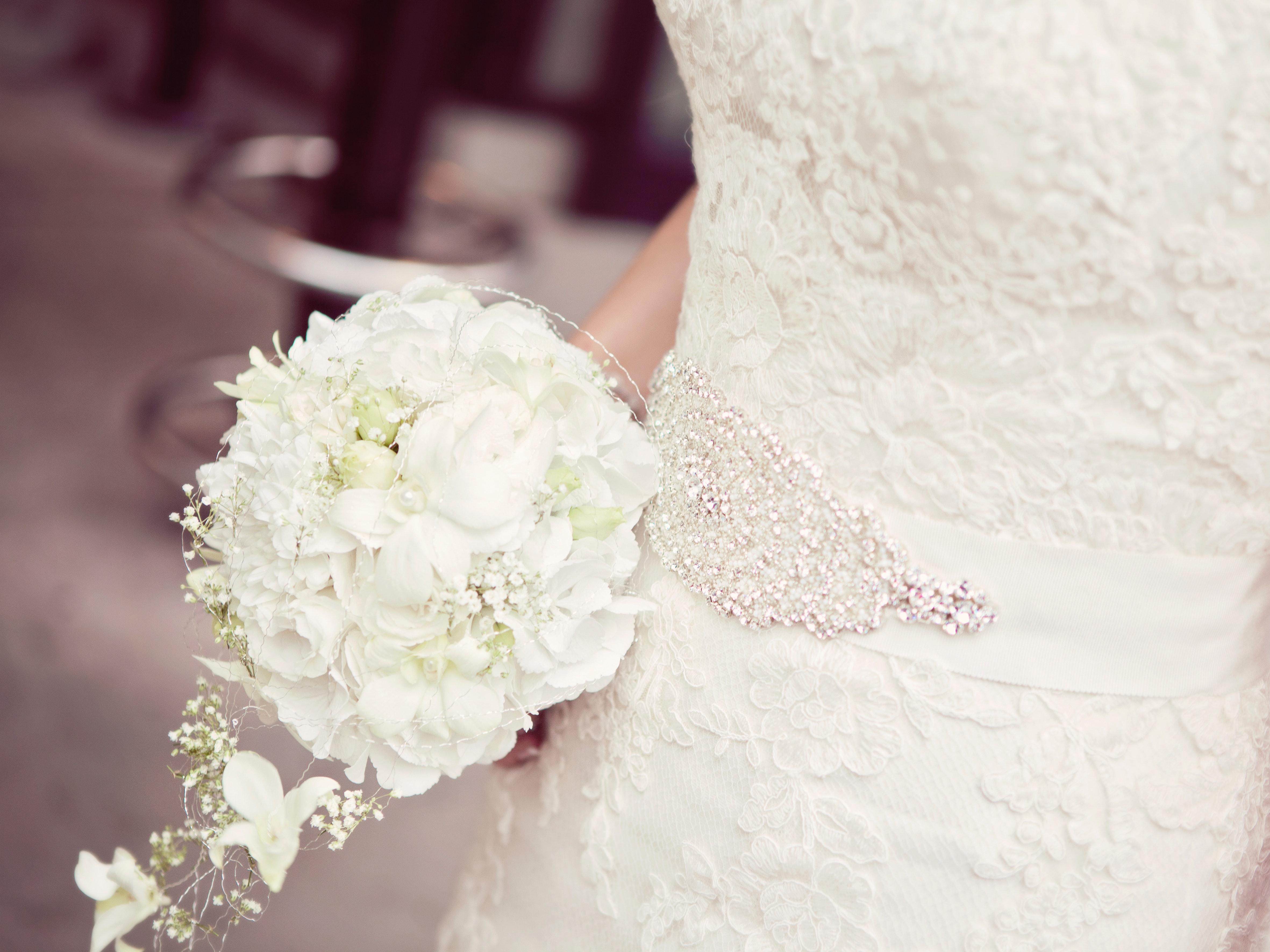 Woman carrying wedding flower photo