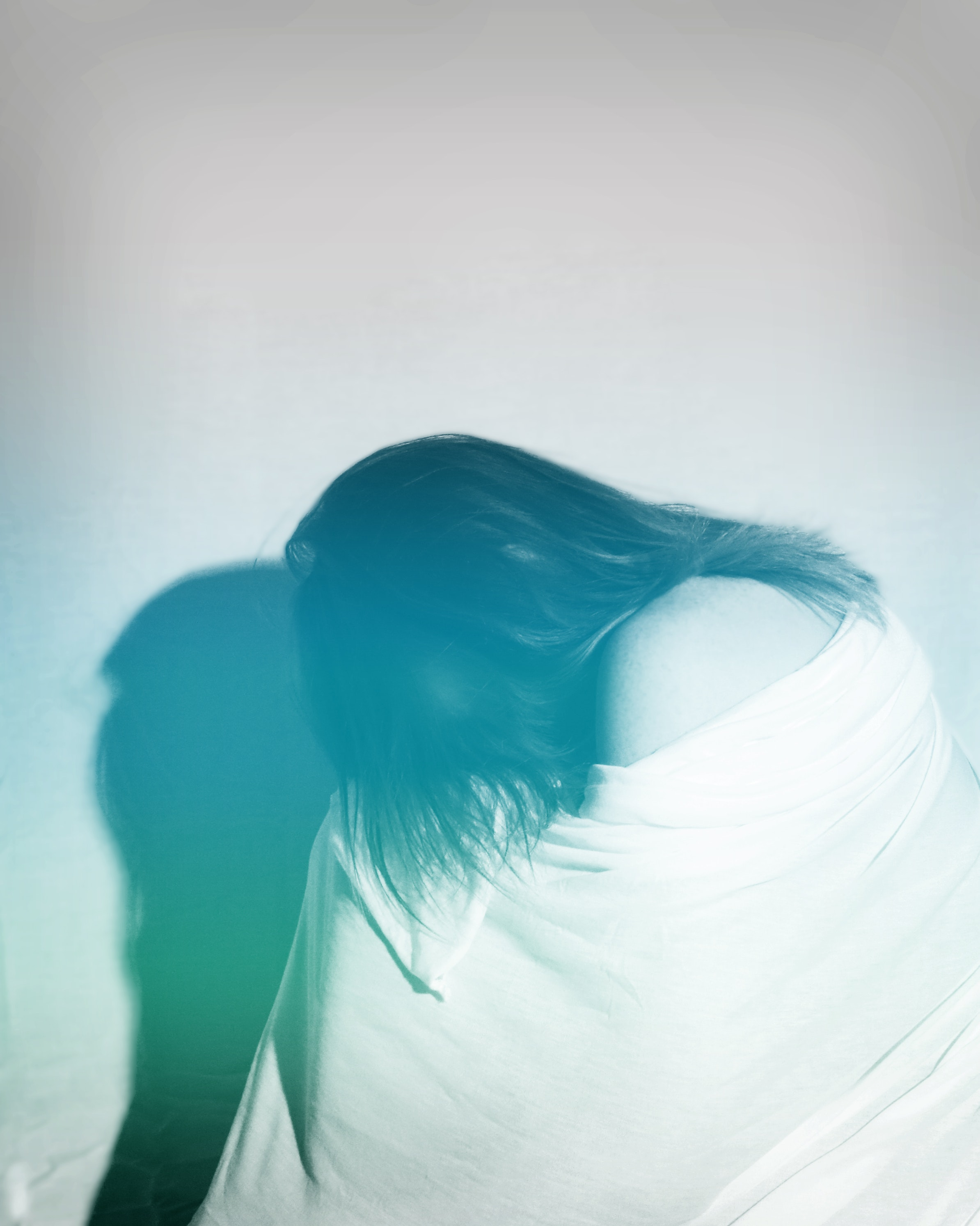 Woman covered by white cloth photo