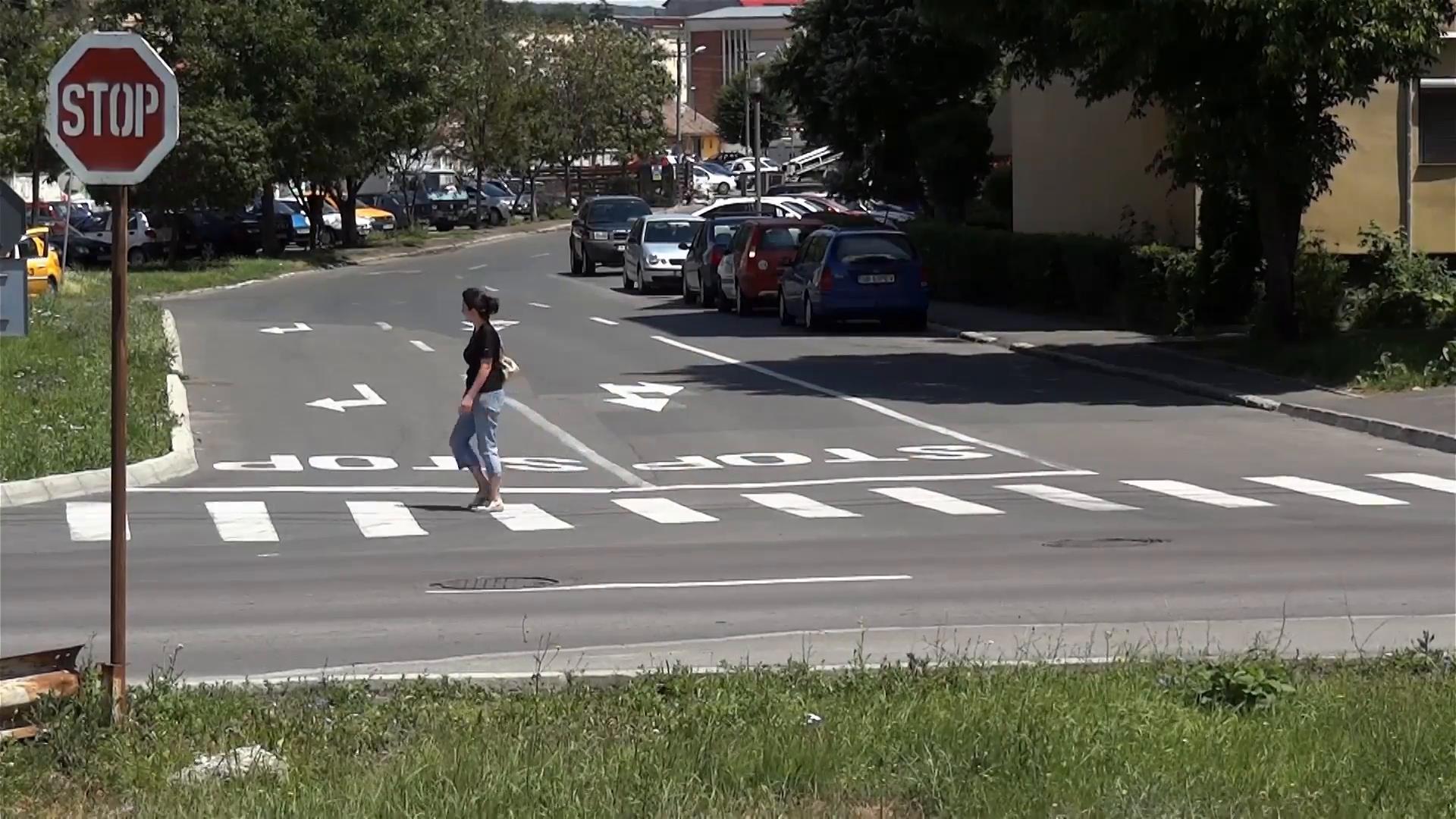 Woman crossing pedestrian photo