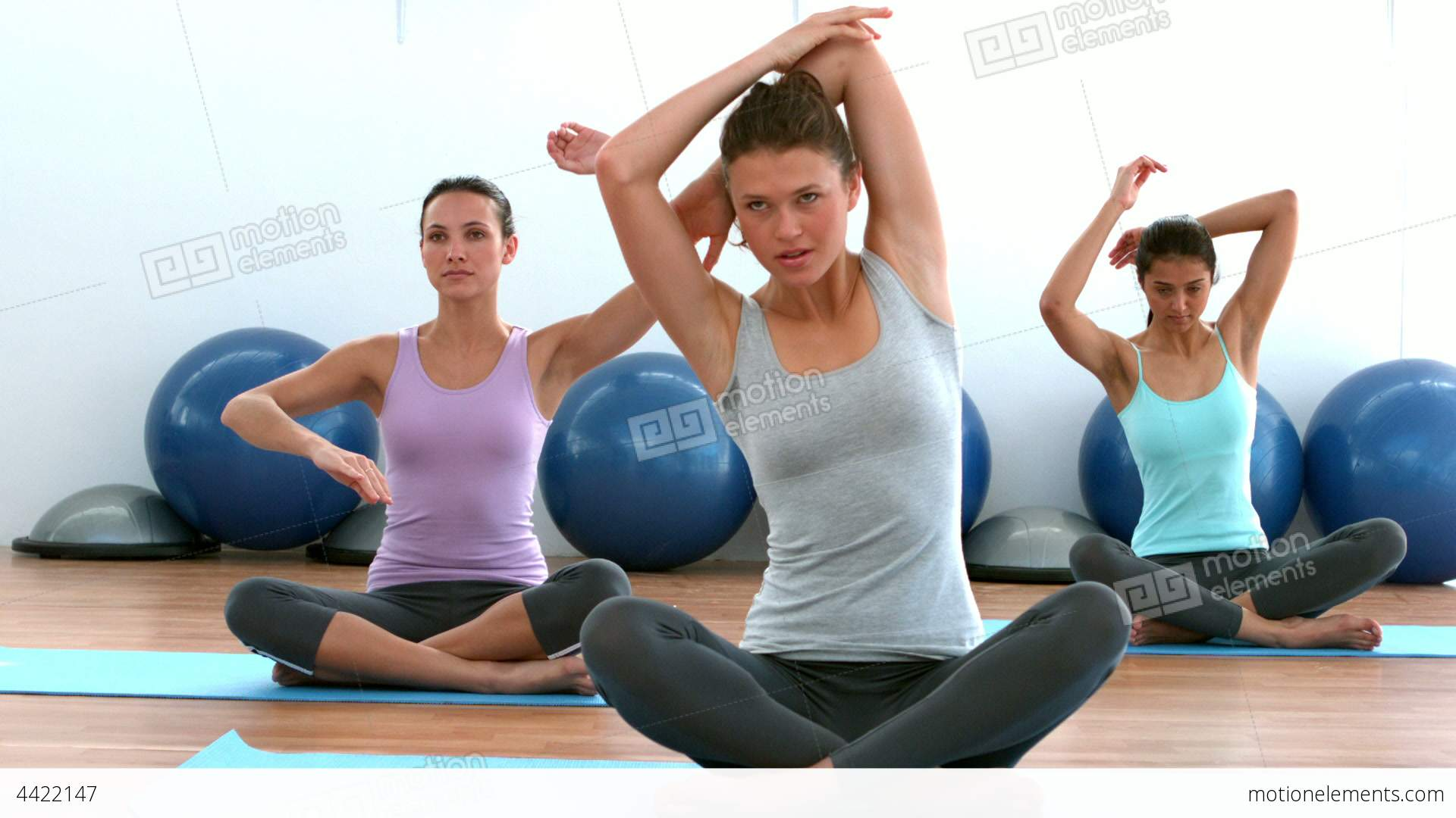 Fit Women Doing Yoga Together In Studio Stock video footage | 4422147