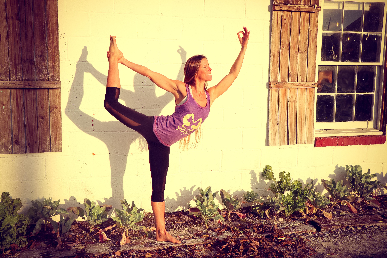 Woman doing yoga at garden photo