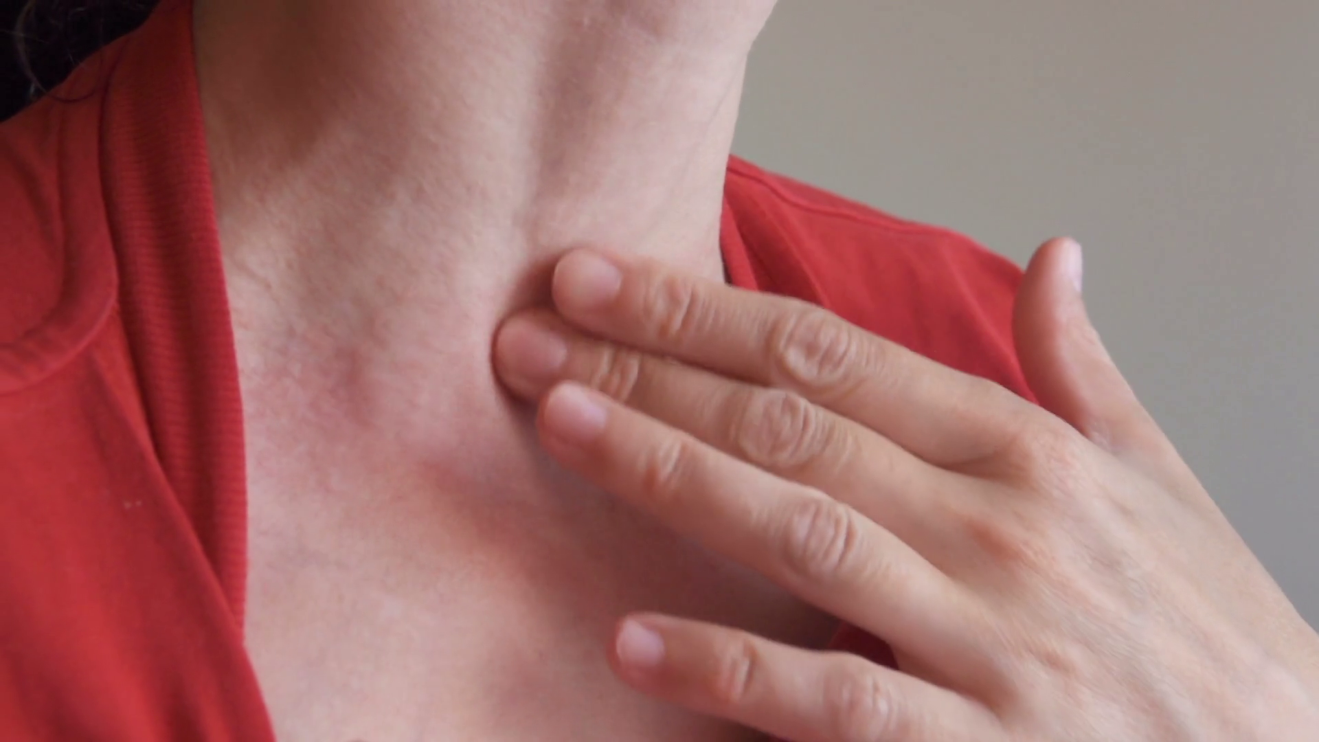 Woman scratch the itch with hand, Neck. Red spots on the neck ...