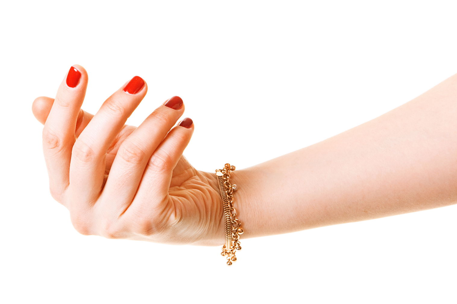 Woman hand with gold bracelet photo